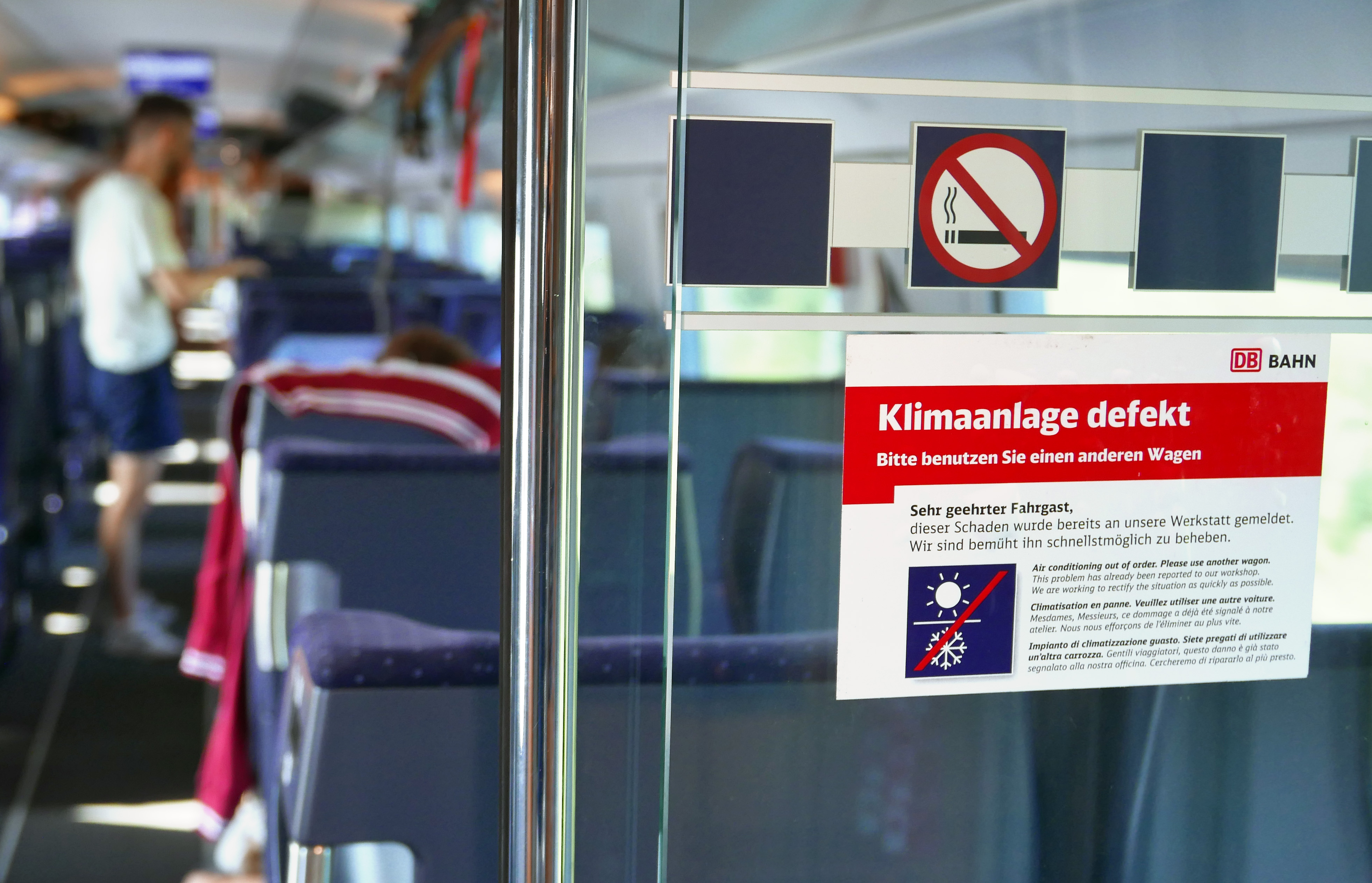 "A sticker on a train from Munich to Berlin reads: ""Air conditioning defective."" (Martin Schutt/DPA/Getty Images)"