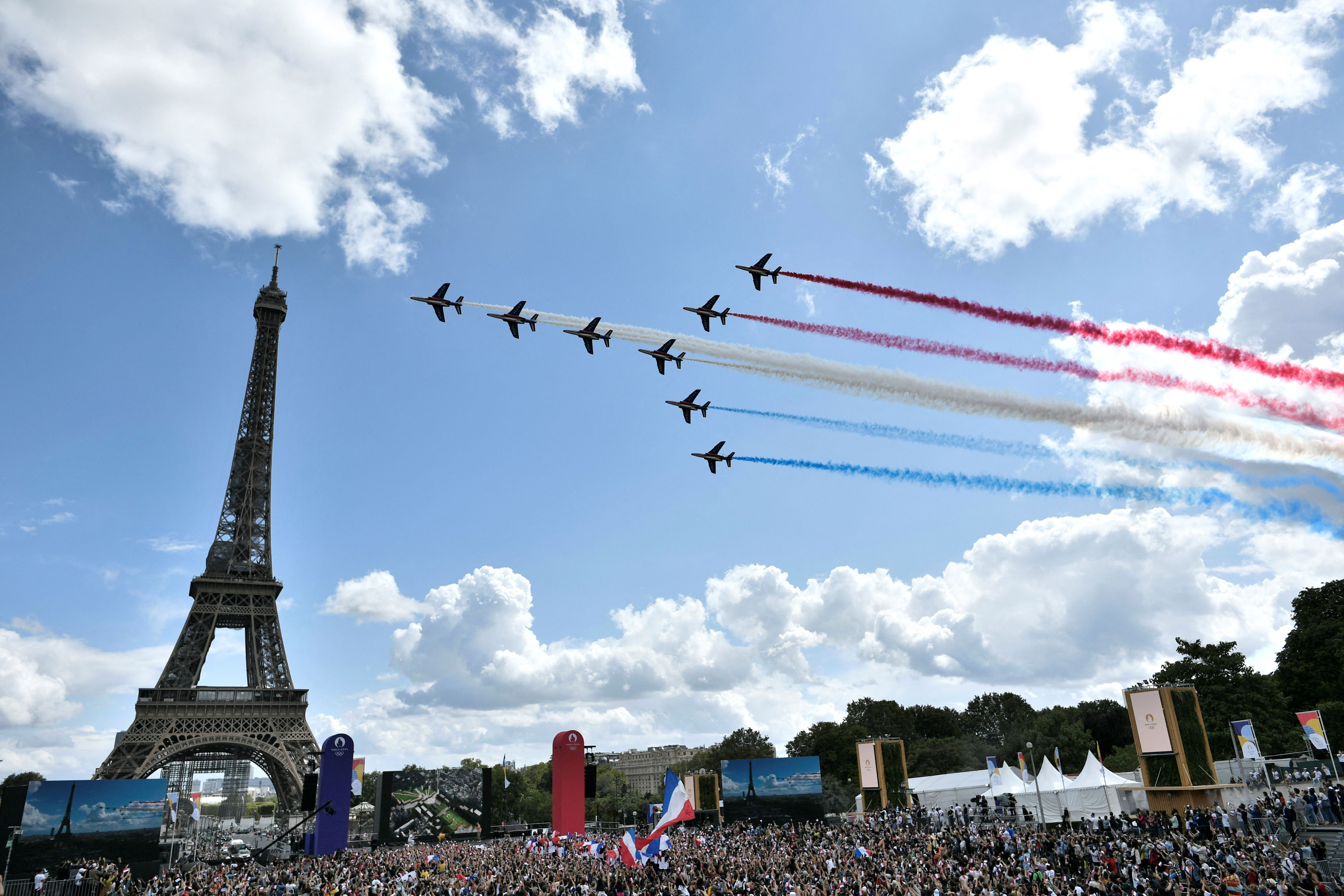 The Patrouille de France fly over celebrations at the Trocadéro in Paris.
