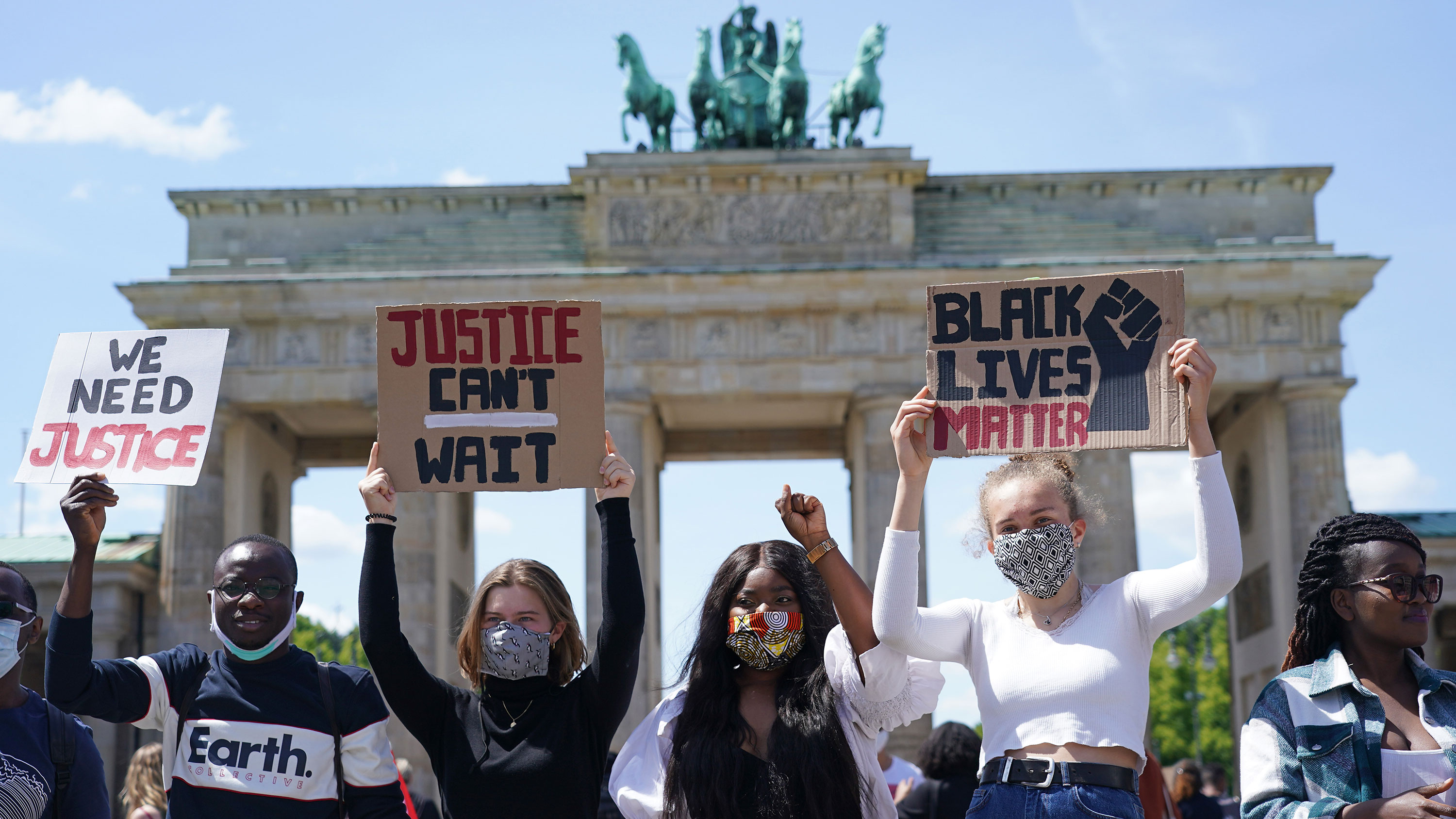 People participate in a protest in front of the Brandenburg Gate in Berlin on May 31.