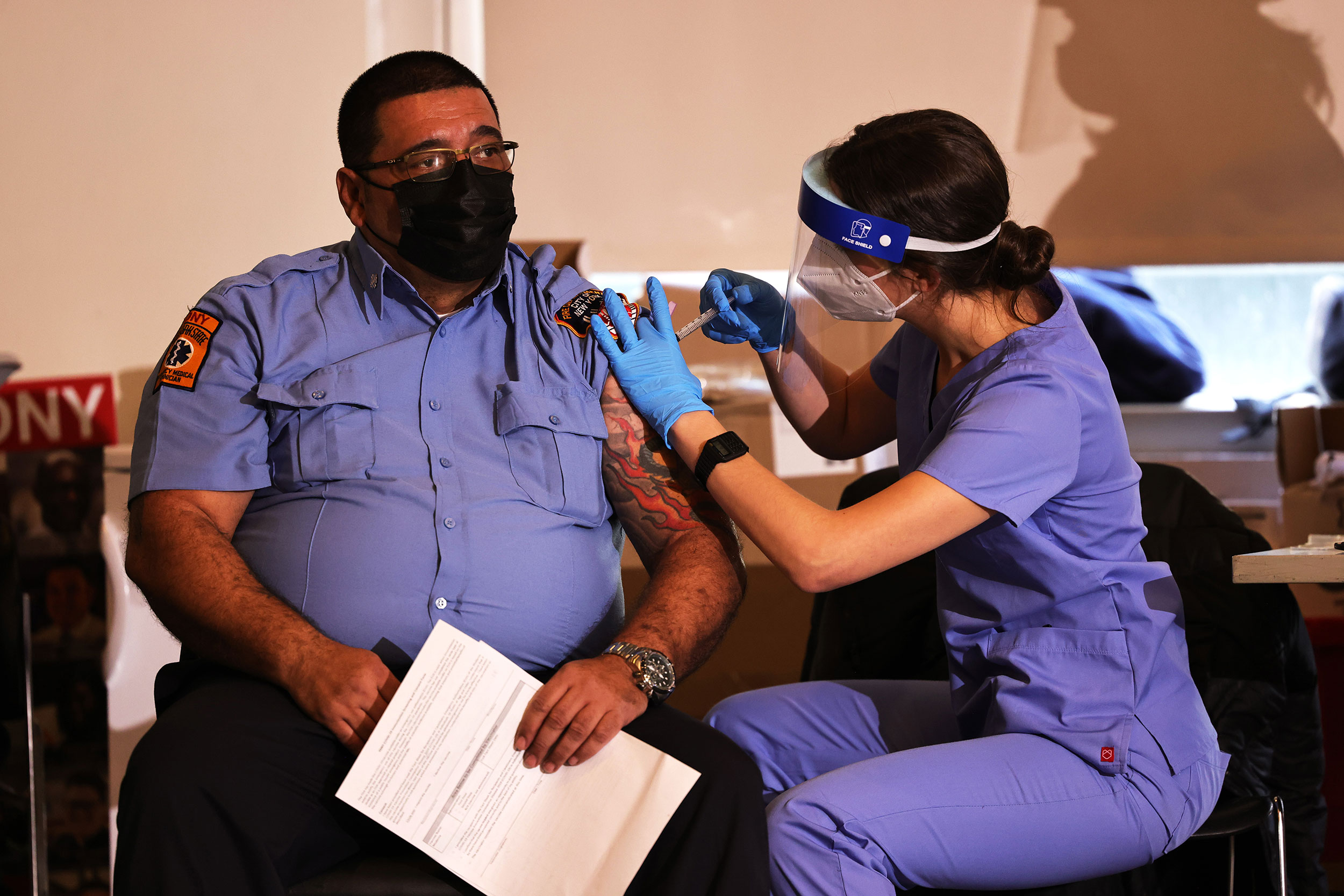 A member of FDNY EMS receives a Covid-19 vaccine at the FDNY Fire Training Academy in New York on December 23.