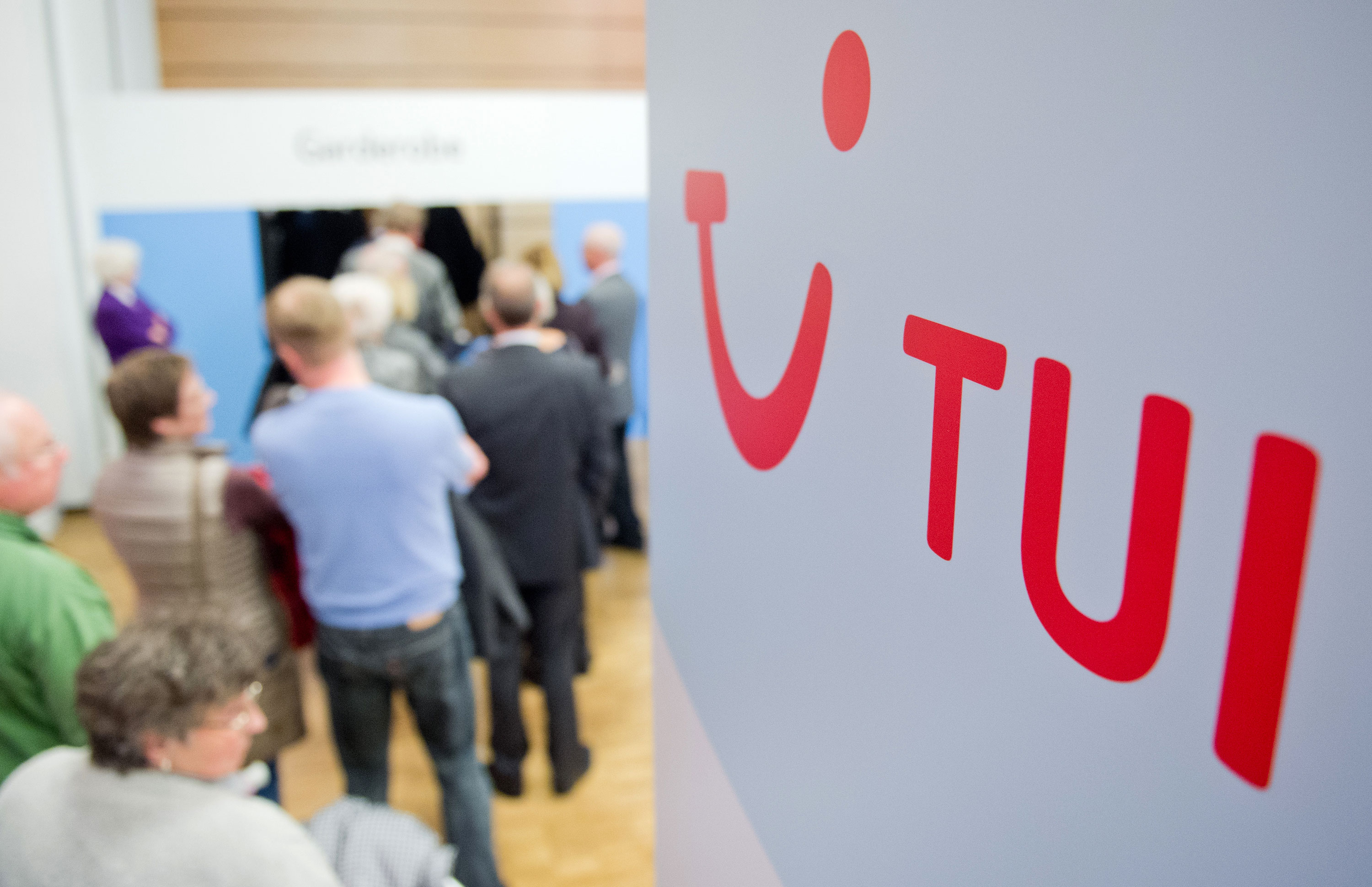 Shareholders arrive to attend the annual general meeting of tourism group TUI in Hanover, Germany, on February 9, 2016.