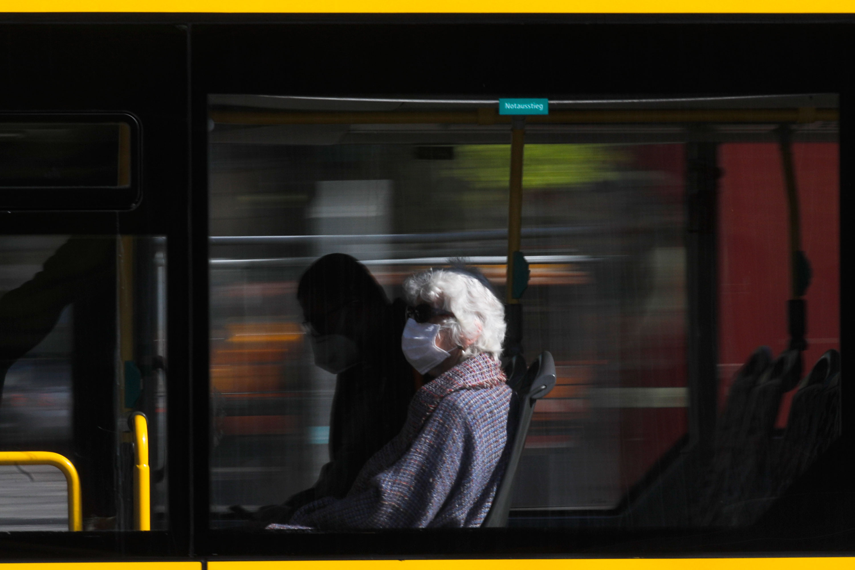 A woman with a face mask sits in a bus in Berlin, Germany, on April 22.
