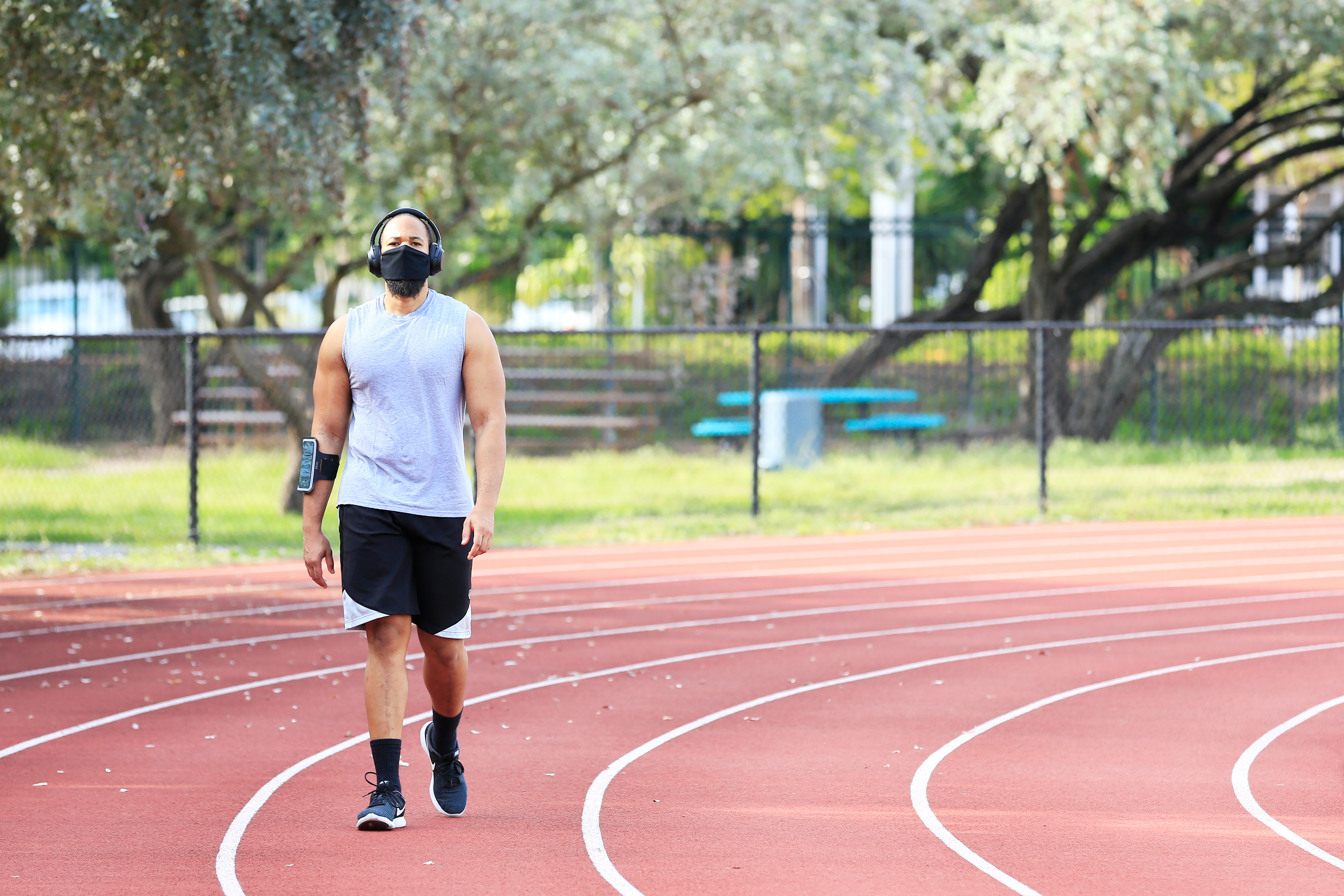 A man wearing a face mask exercises on the track in Flamingo Park on April 29 in Miami Beach, Florida.