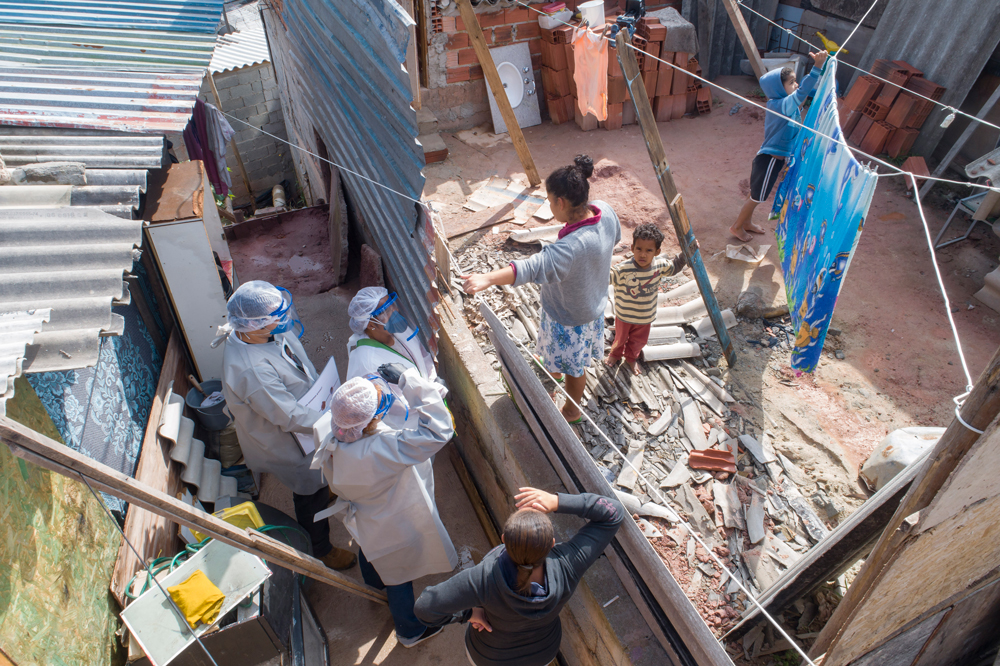Health workers from Doctors Without Borders visit a squatters camp to conduct medical examinations to avoid the spread of the new coronavirus in Sao Bernardo do Campo in the greater Sao Paulo area of Brazil on Wednesday.