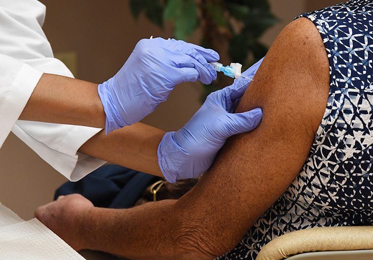 A Moderna COVID-19 vaccine is being administered at the Doolittle Senior Center on February 3, 2021 in Las Vegas, Nevada.