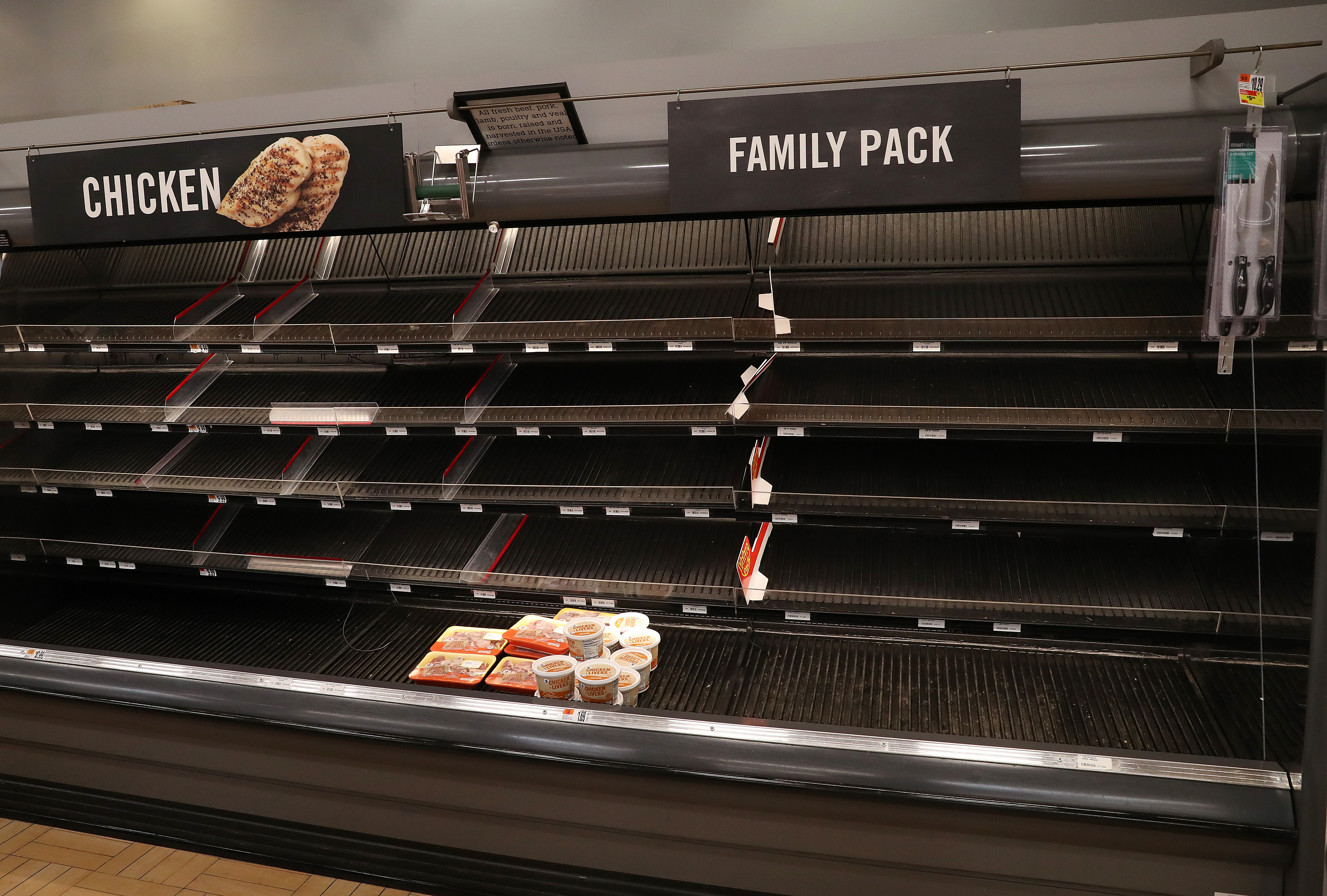 Shelves normally stocked with meat sit empty at a Giant grocery store in Dunkirk, Maryland, on March 13.