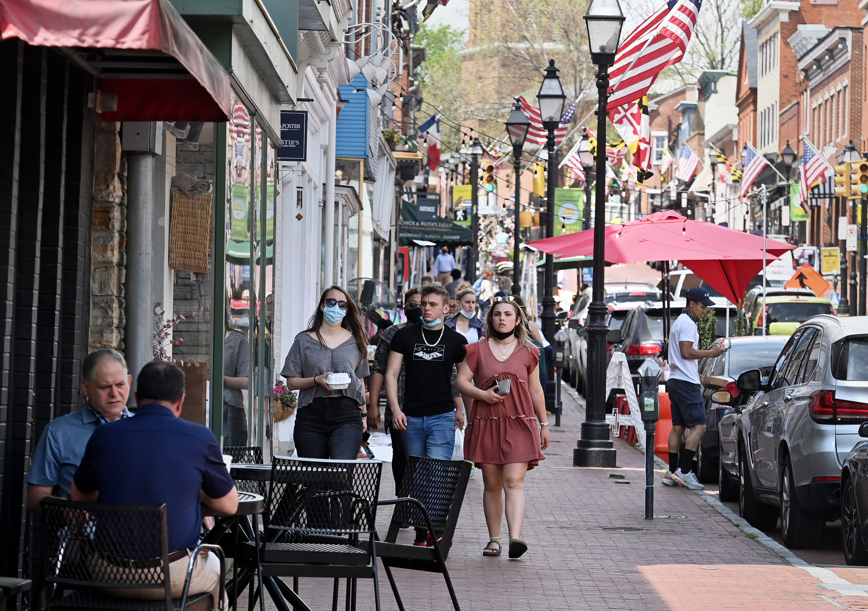 People walk down the street in Annapolis, Maryland, on April 29.