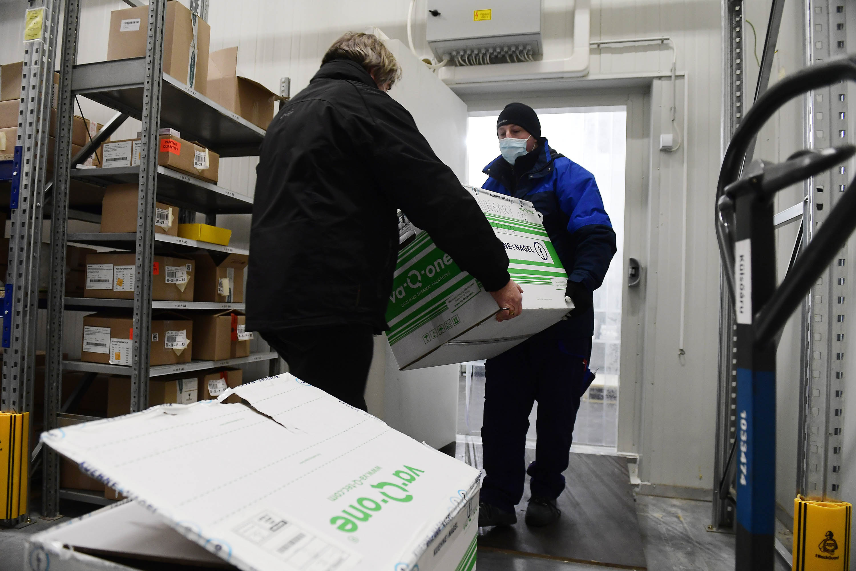 The men have been carrying a box containing the Moderna COVID-19 vaccine since the first shipment arrived in Budapest, Hungary, on January 12th.