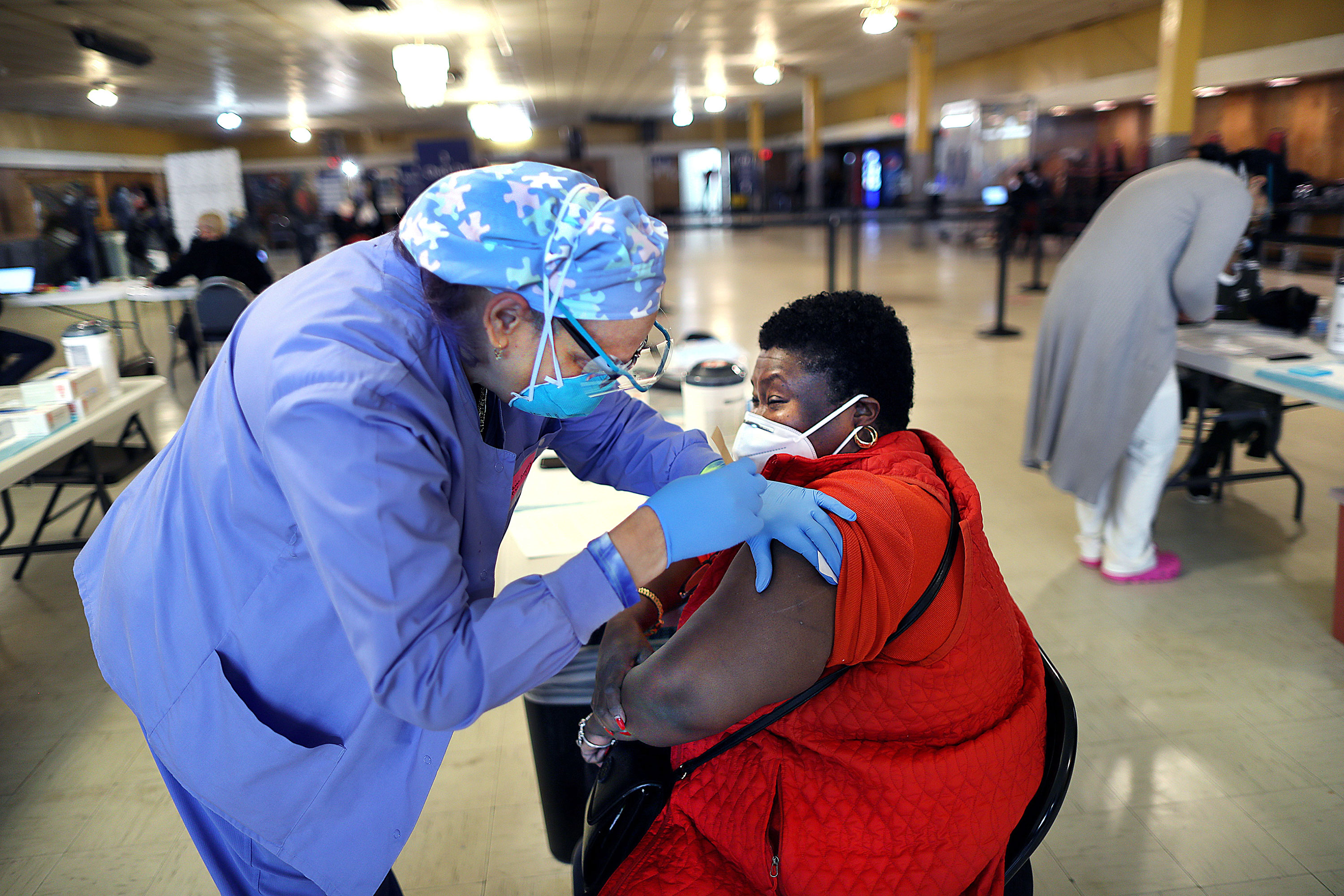 A woman receives the Moderna Covid-19 vaccine in Boston on February 23.