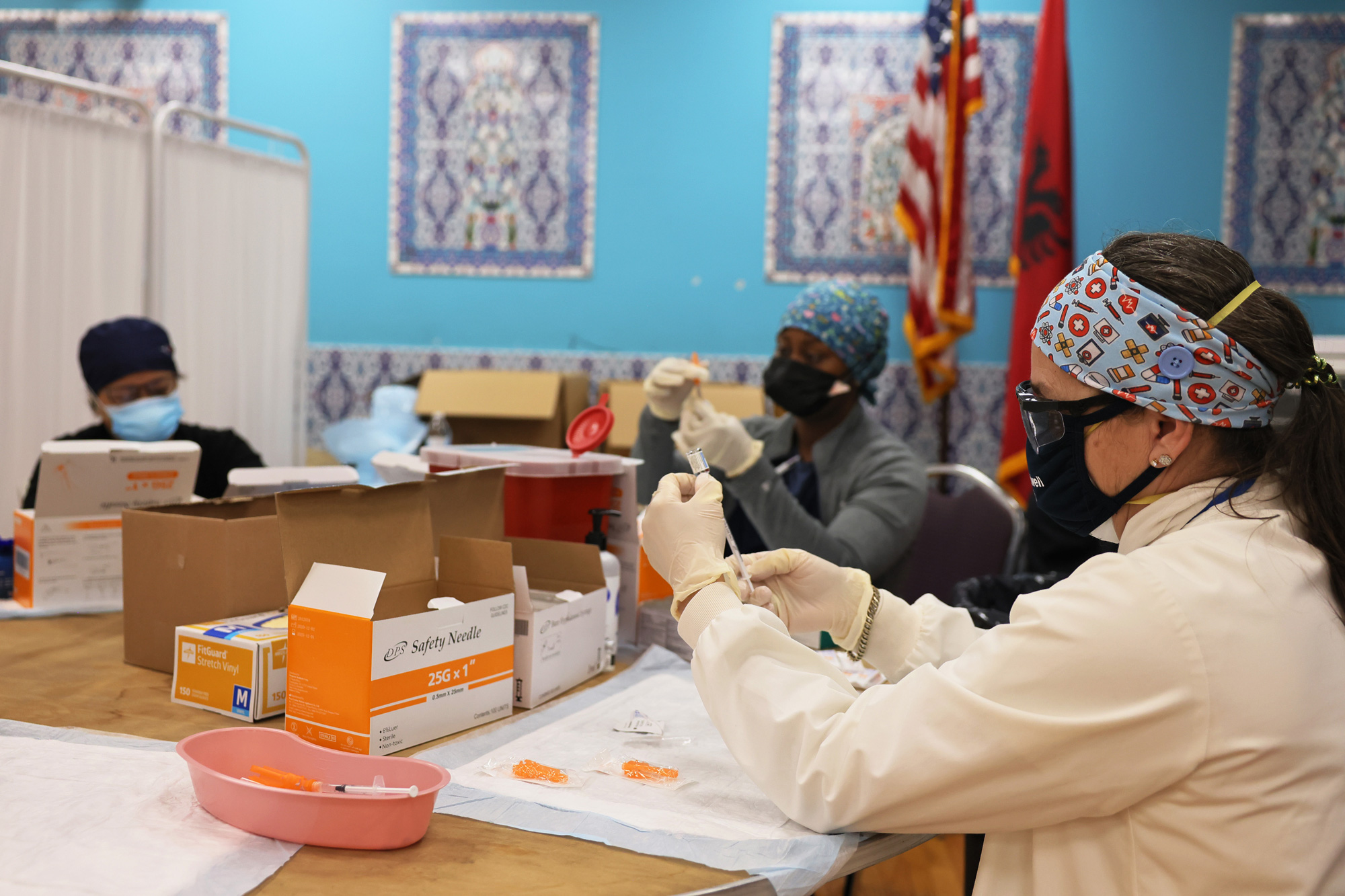 Northwell Health medical staff members prepare doses of the Johnson & Johnson coronavirus vaccine at the Northwell Health pop-up coronavirus vaccination site at the Albanian Islamic Cultural Center in Staten Island on April 8 in New York City.