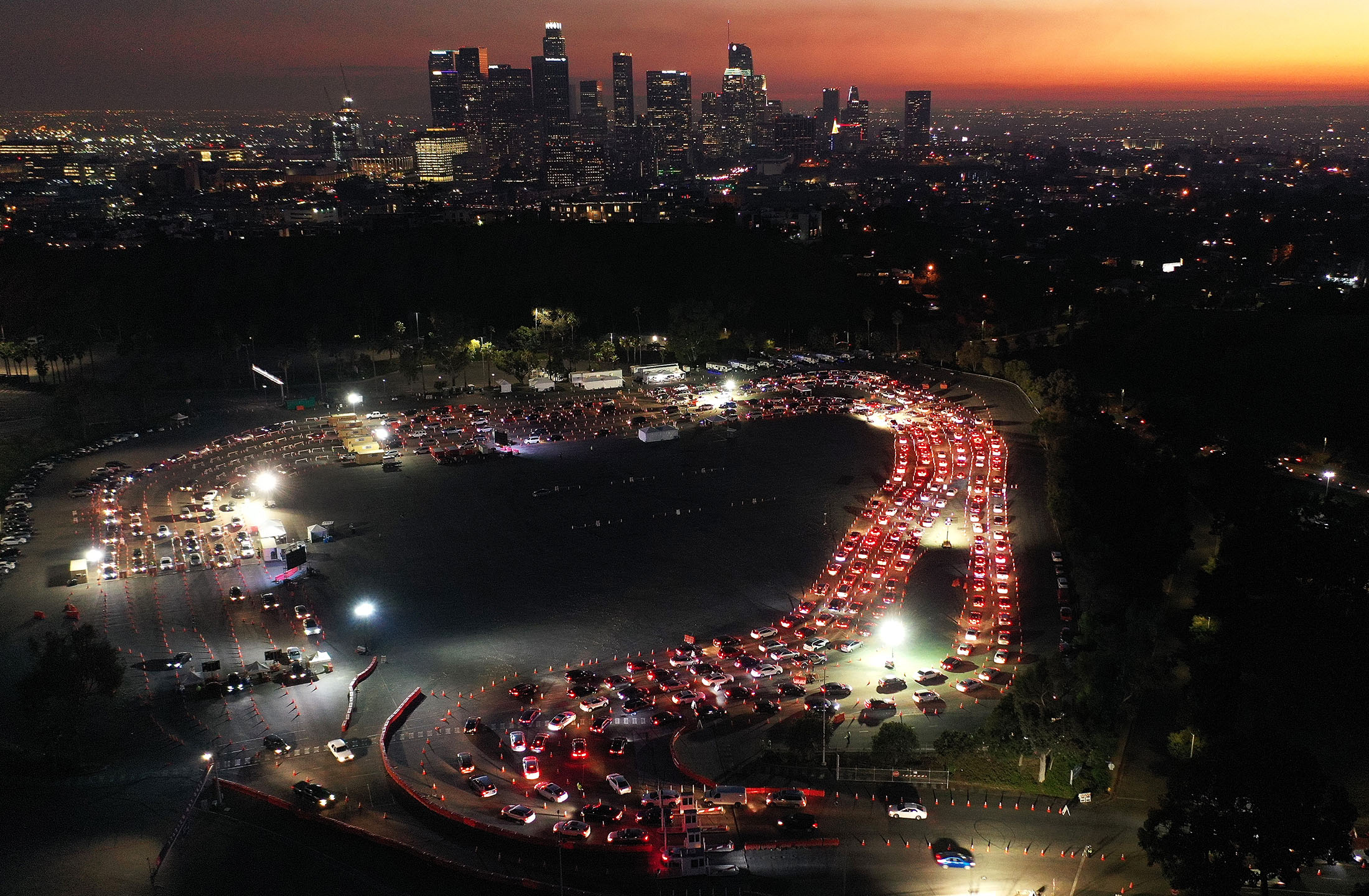 An aerial view of cars are lined up at Dodger Stadium for COVID-19 testing over downtown Los Angeles, on December 2.