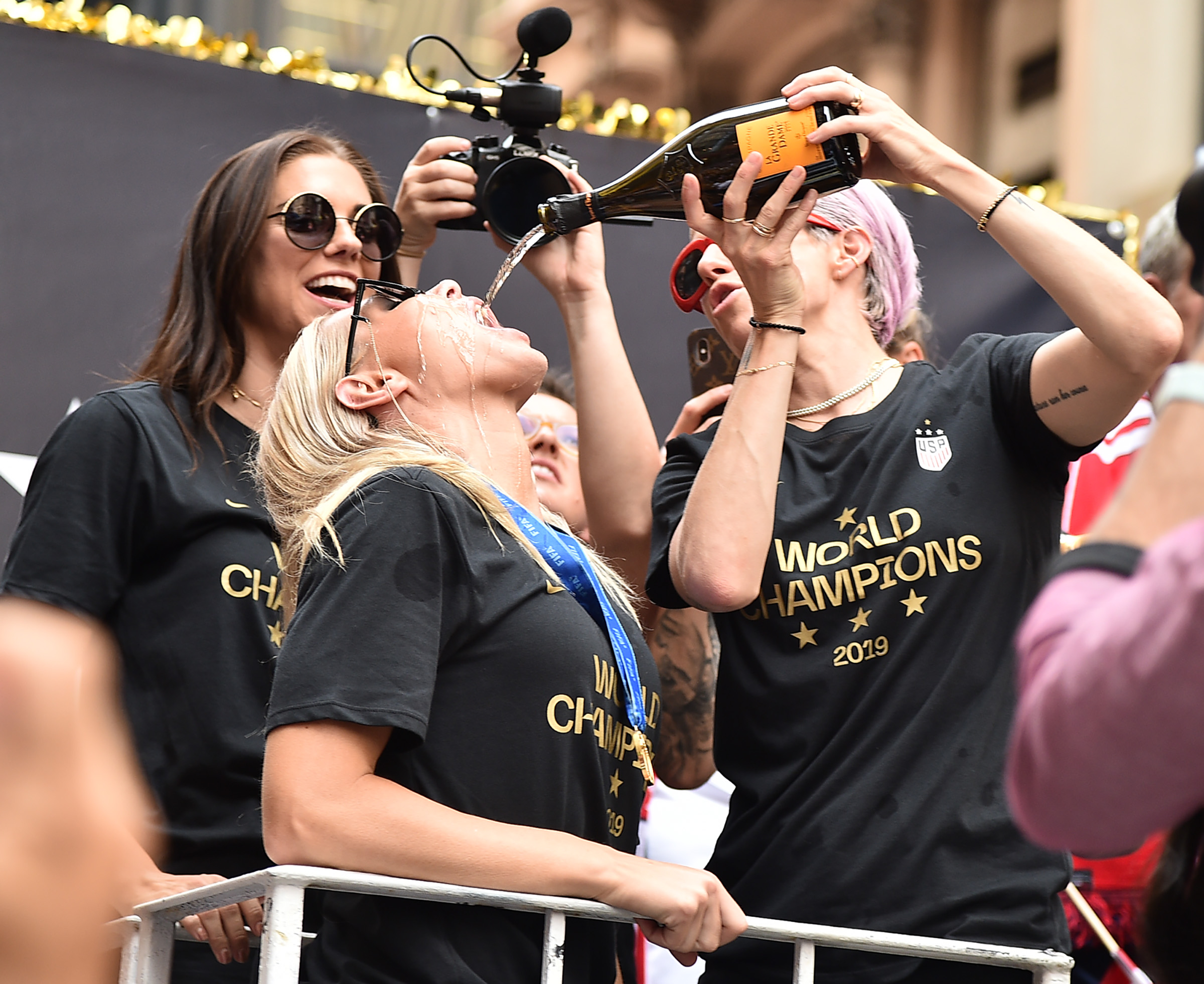 Alex Morgan, Allie Long and Megan Rapinoe during The US Women's National Soccer Team victory parade.