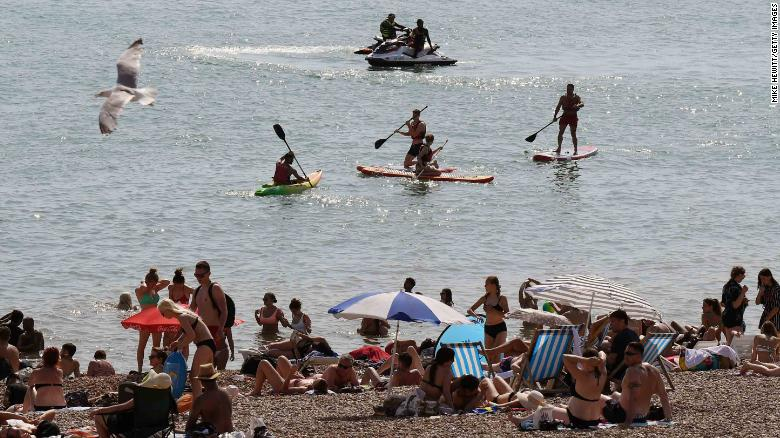 Many flocked to the beach to cool down in Brighton, southern England on Tuesday.