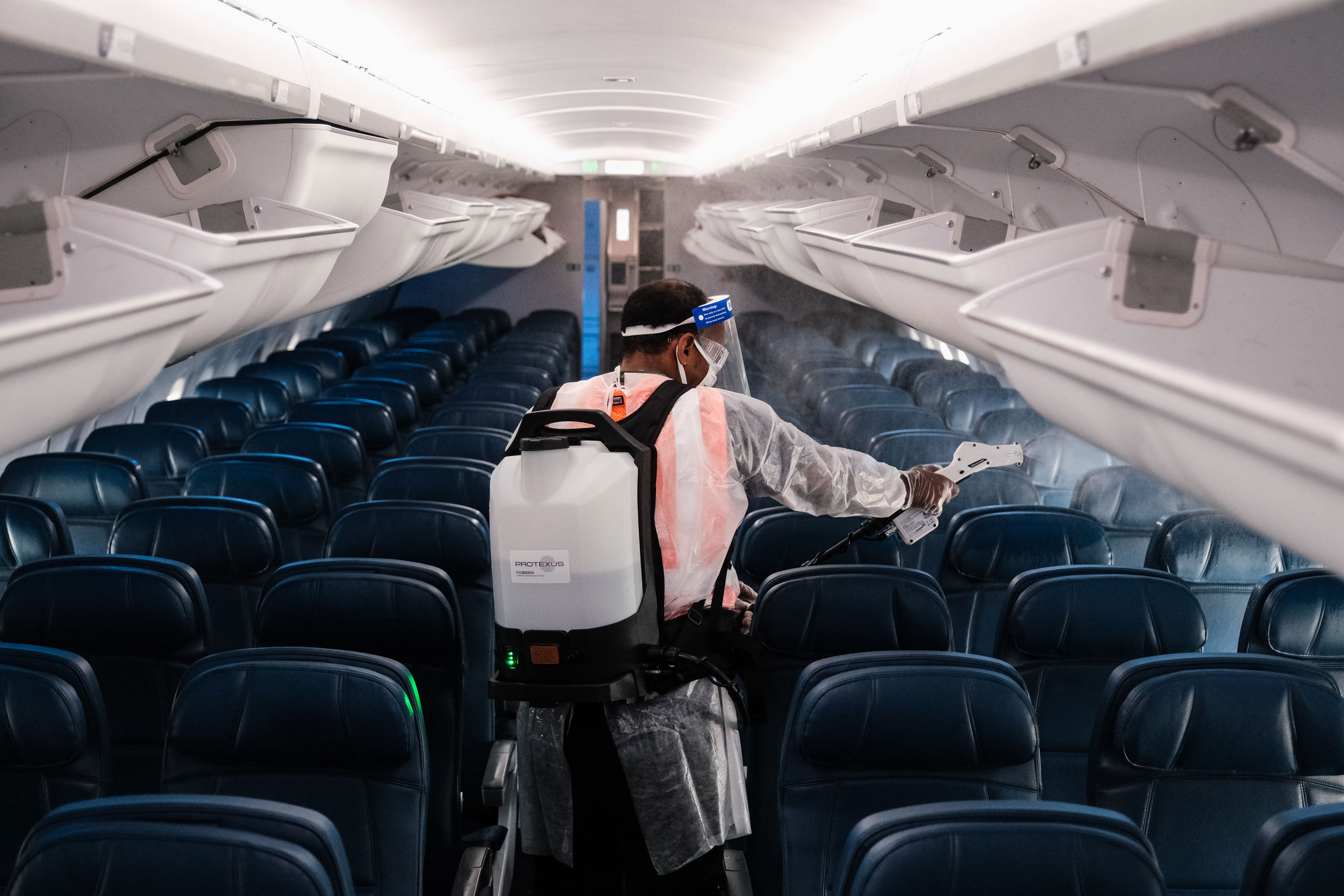 An airport employee performs an aircraft disinfecting demonstration during a media preview at the Ronald Reagan National Airport on July 22.