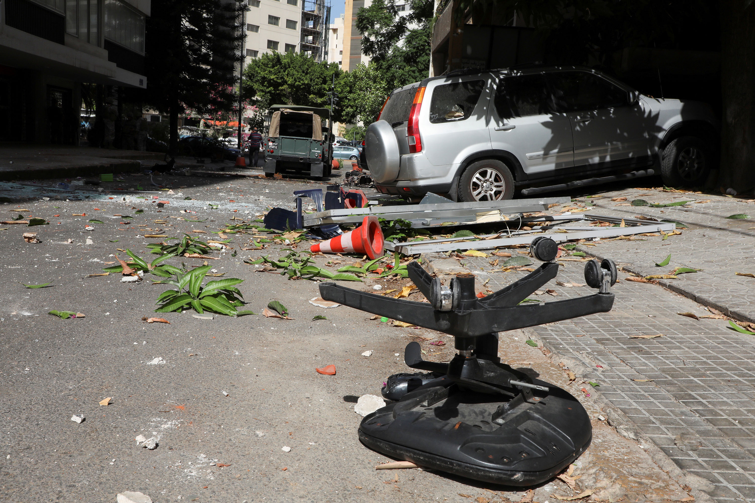 Shattered glass and debris are seen after gunfire erupted at a site near a protest against Judge Tarek Bitar in Beirut, Lebanon, on October 14.