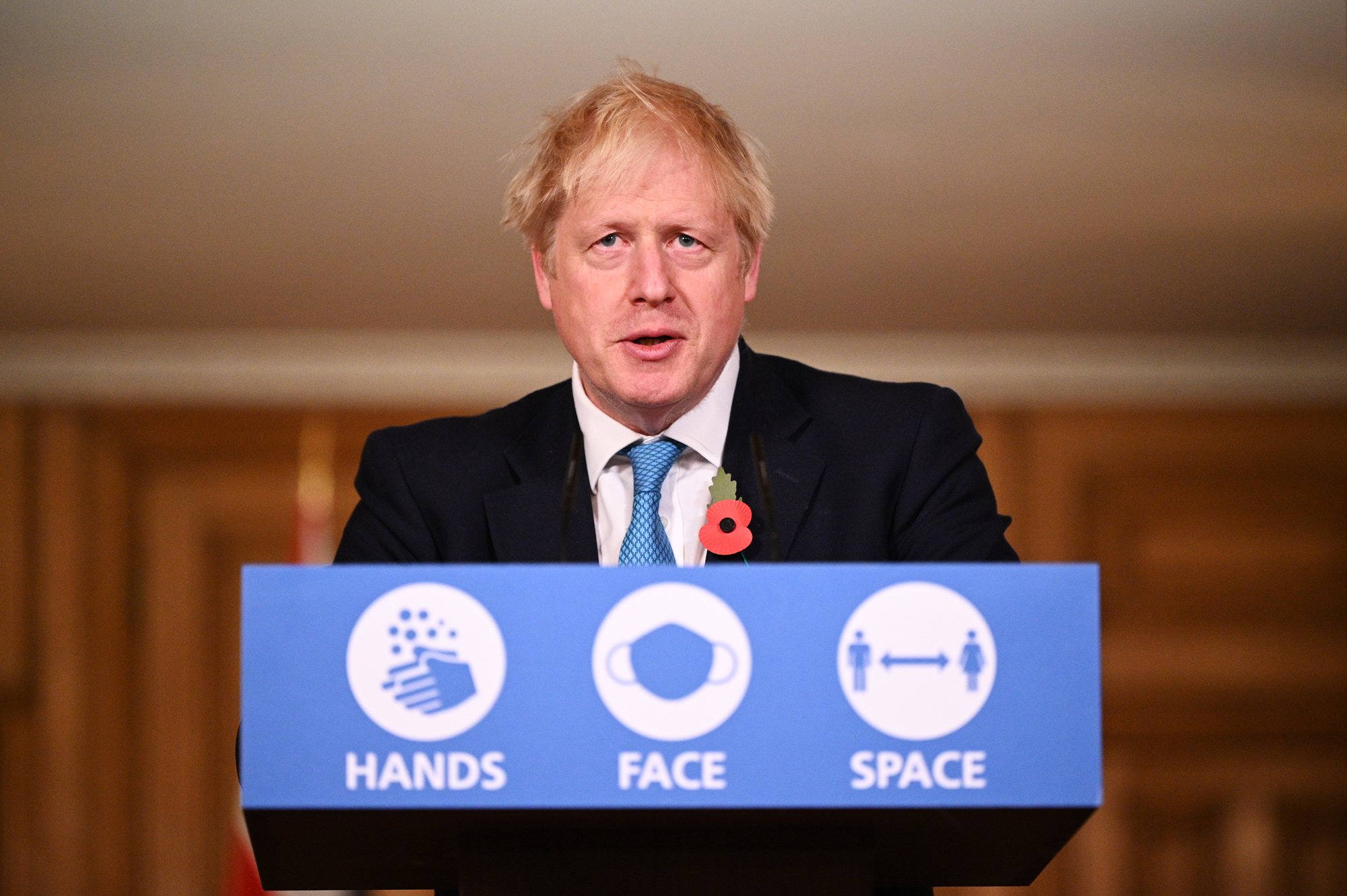 UK Prime Minister Boris Johnson answers questions during a briefing in Downing Street on November 5 in London.