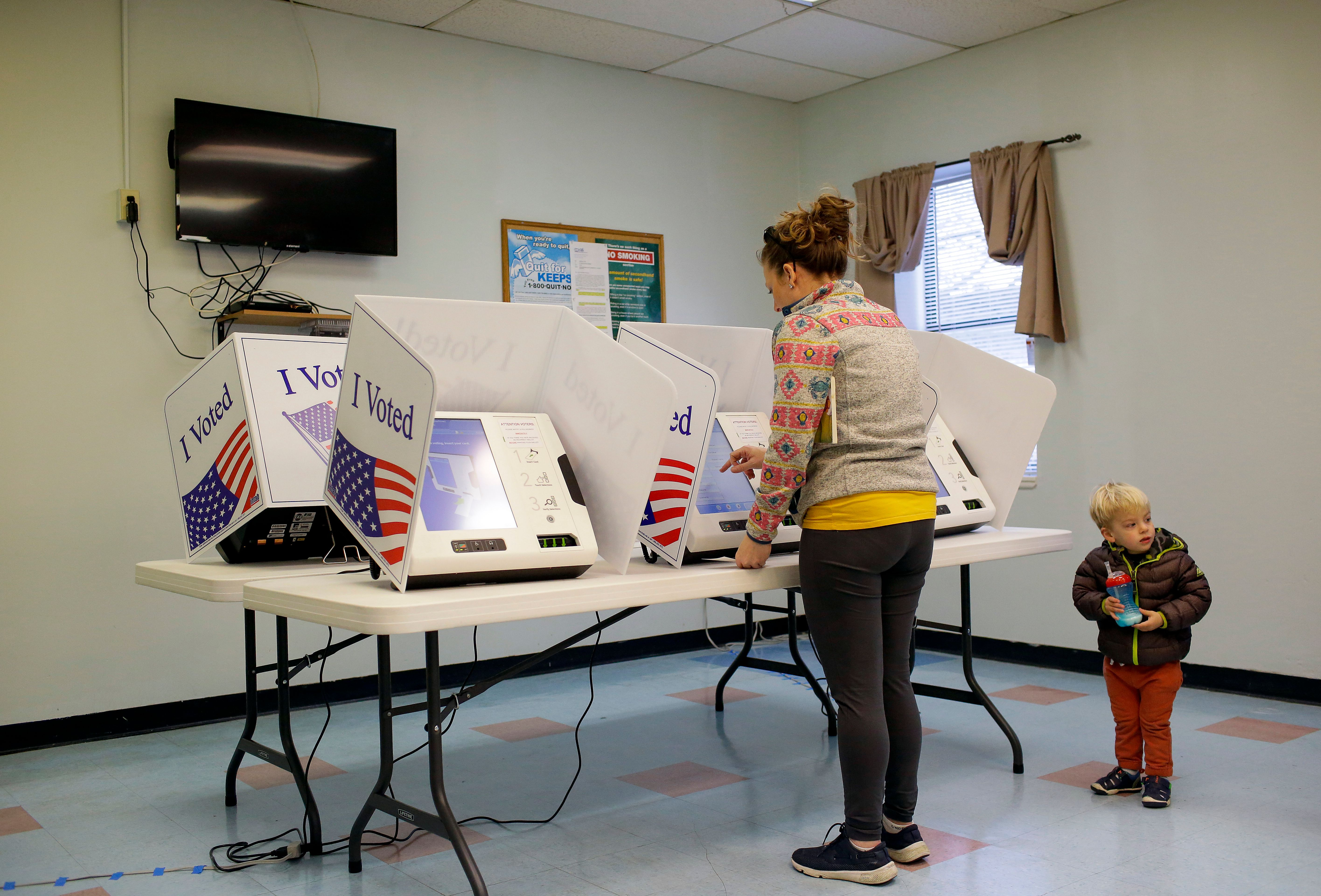 A voter fills out a ballot at a polling station located at the Charleston County Housing and Redevelopment Authority during the primary election in Charleston, South Carolina, on February 29, 2020.