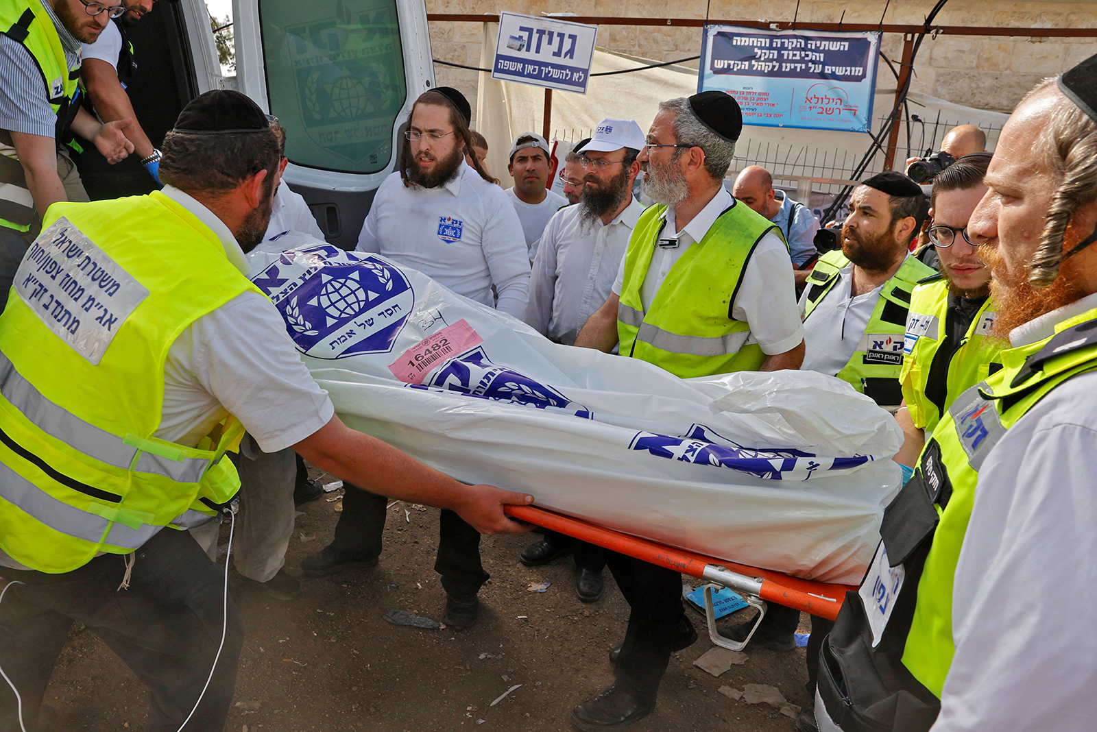 Israeli rescue teams carry a body bag into an ambulance in Meron, Israel, on April 30.