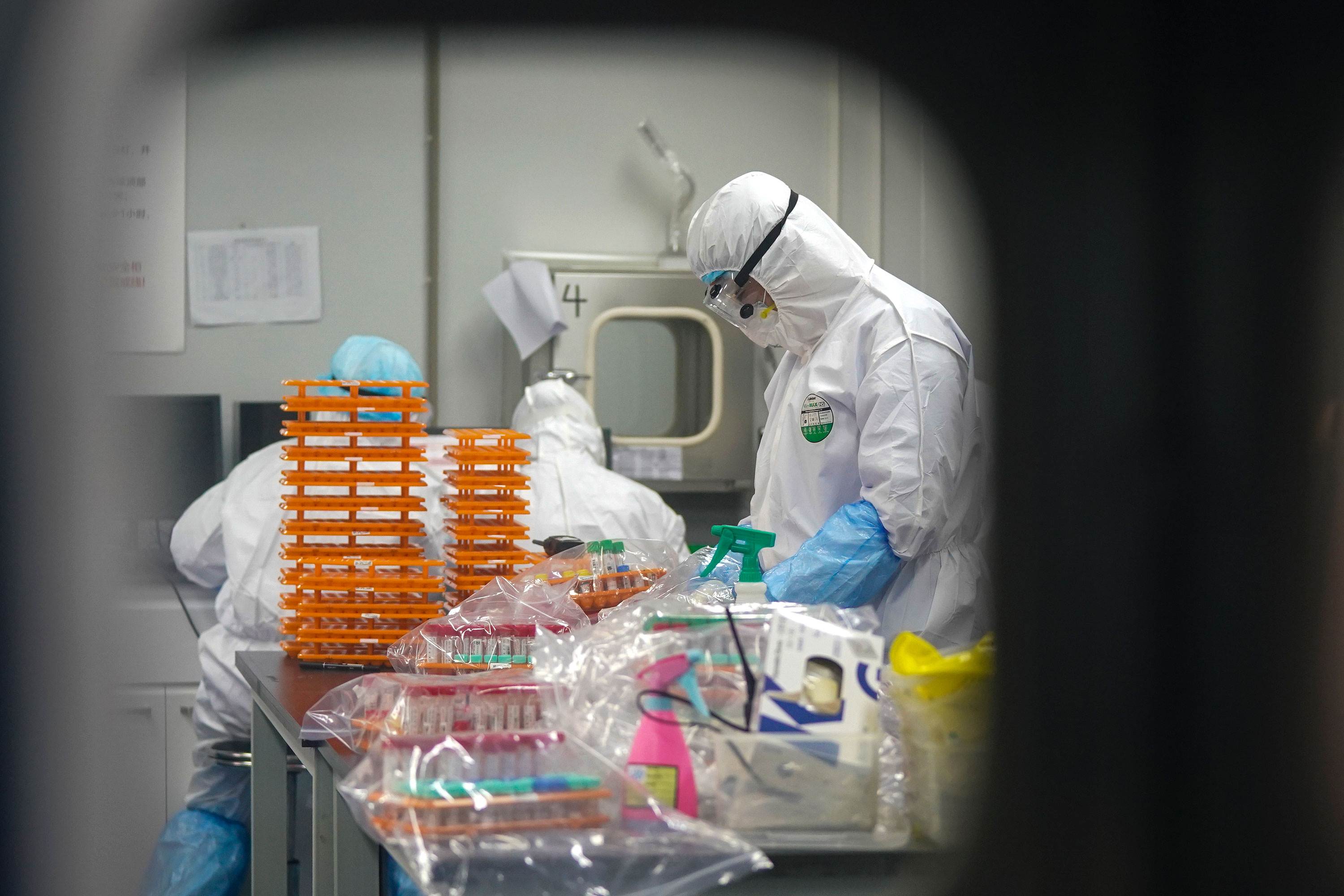 Medical workers at a coronavirus detection lab in Wuhan, China on February 22.