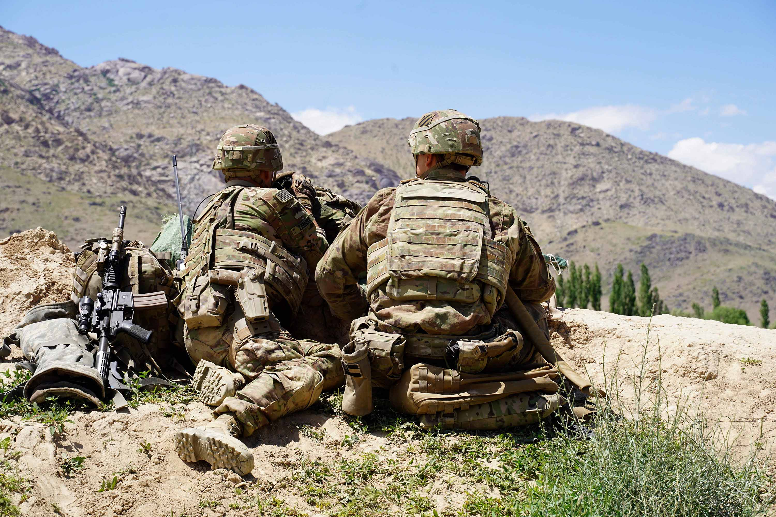 US soldiers look out over hillsides during a visit of General Scott Miller at the Afghan National Army (ANA) checkpoint in the Nerkh district of Afghanistan's Wardak province, in June 2019.
