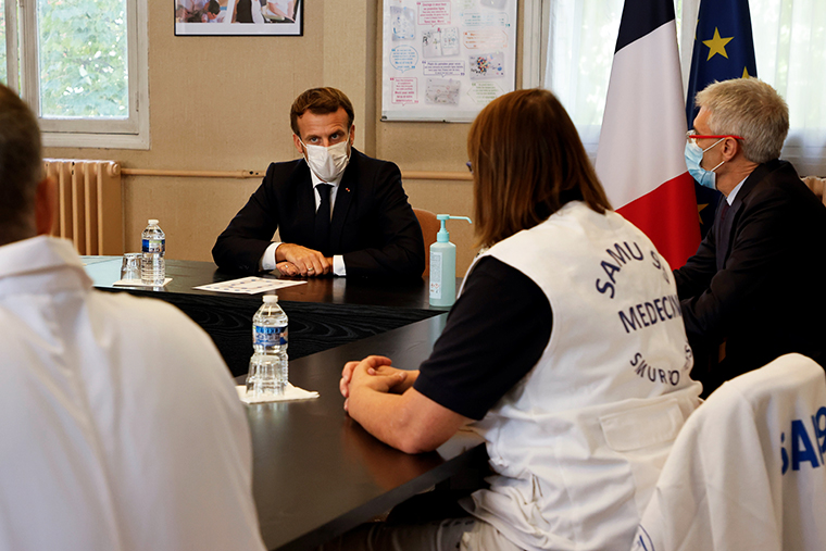 French President Emmanuel Macron (2nd L) chairs a meeting with the medical staff of the René Dubos hospital center, in Pontoise, in the Val d'Oise, on October 23, 2020, as the country faces a new wave of infections to the Covid-19.