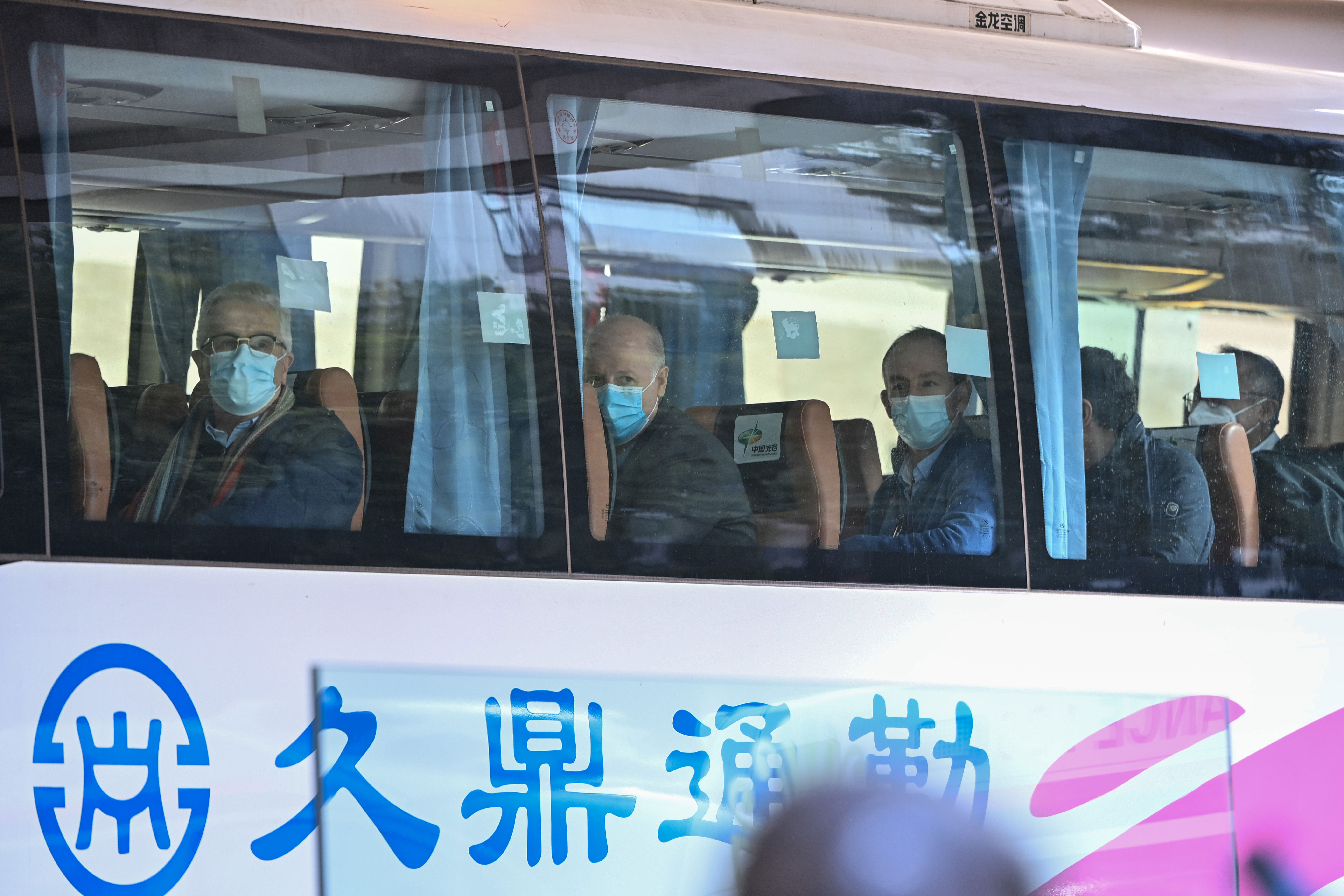 Members of the World Health Organization team investigating the origins of Covid-19 leave The Jade hotel in Wuhan, China, after completing their two-week quarantine on January 28.