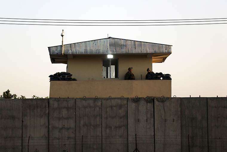 U.S soldiers stand guard at the airport tower near an evacuation control checkpoint during ongoing evacuations at Hamid Karzai International Airport, in Kabul, Afghanistan, Wednesday, August 25.