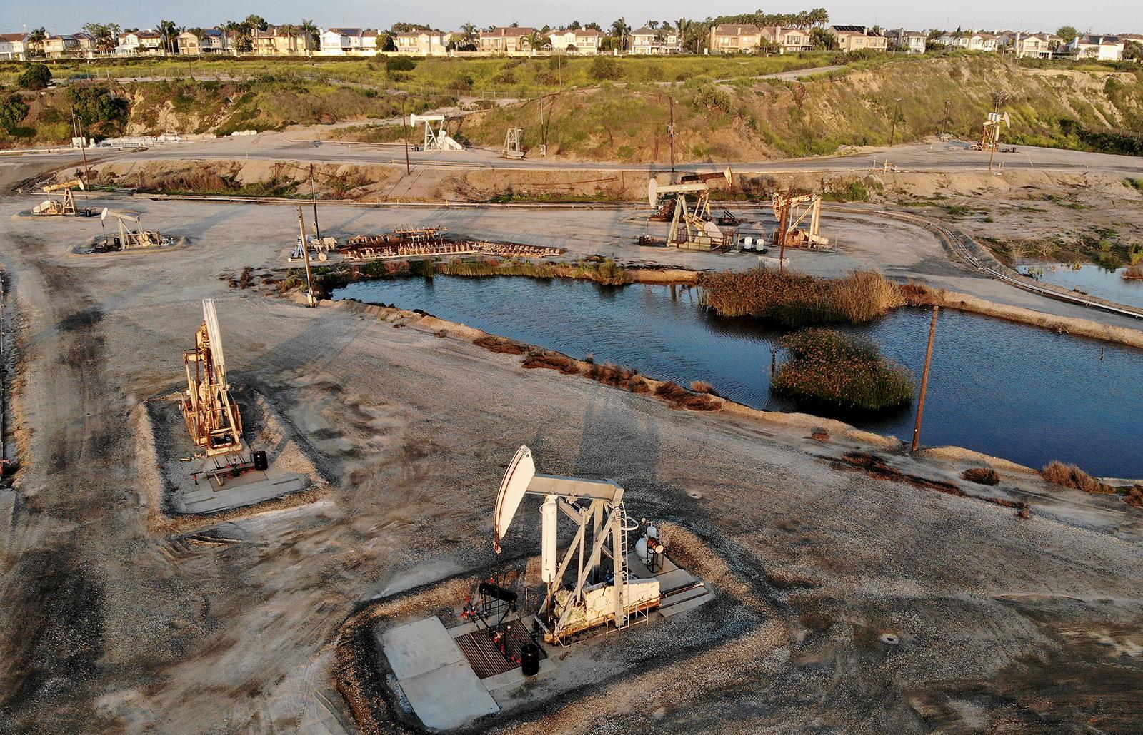 An aerial view shows oil pumpjacks at the Huntington Beach Oil Fields amid the coronavirus pandemic in Huntington Beach, California on April 20.