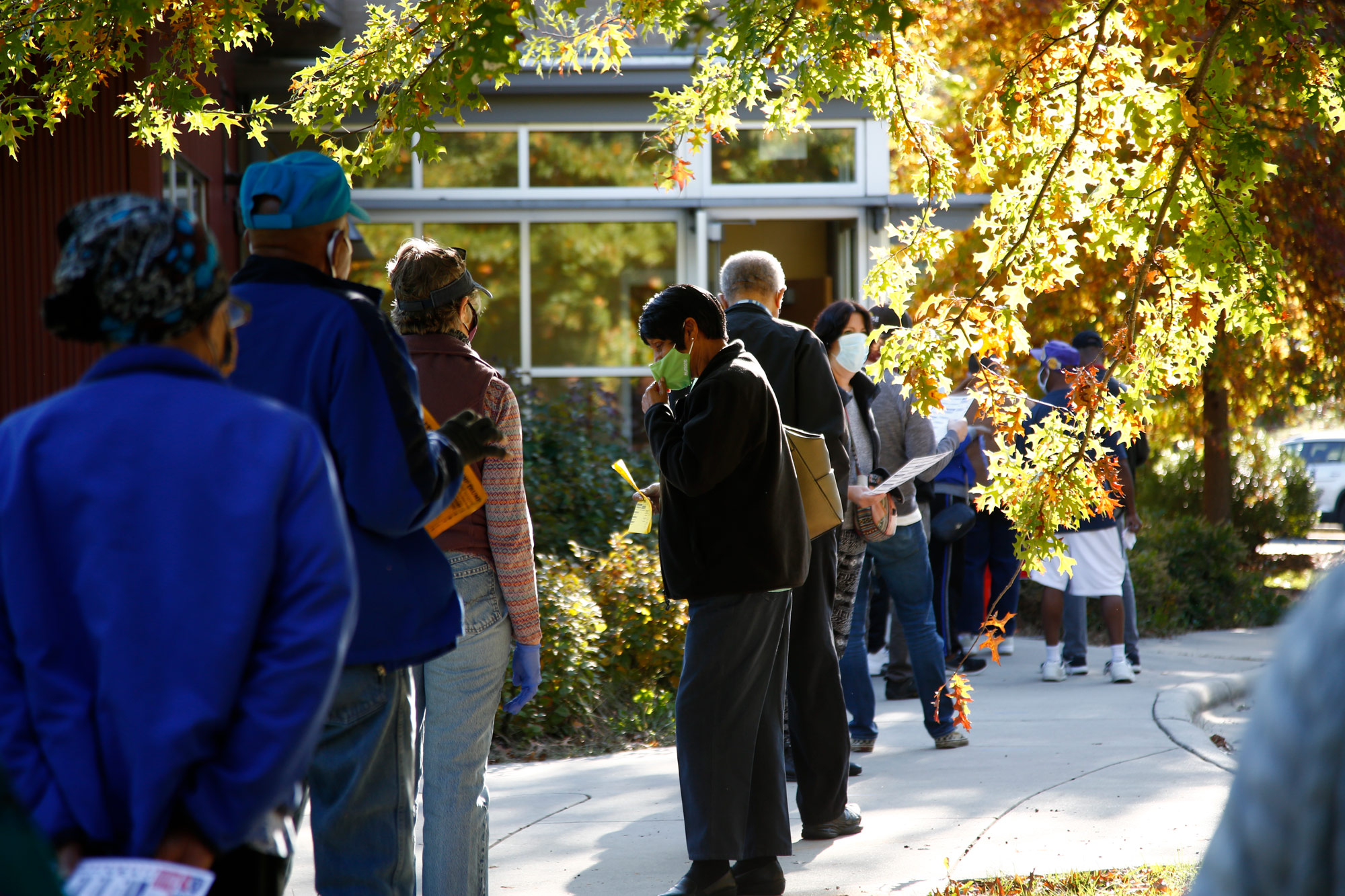 Voters wait in line to vote at a polling place at the Dr. Wesley Grant Senior Center on October 15 in Asheville, North Carolina.