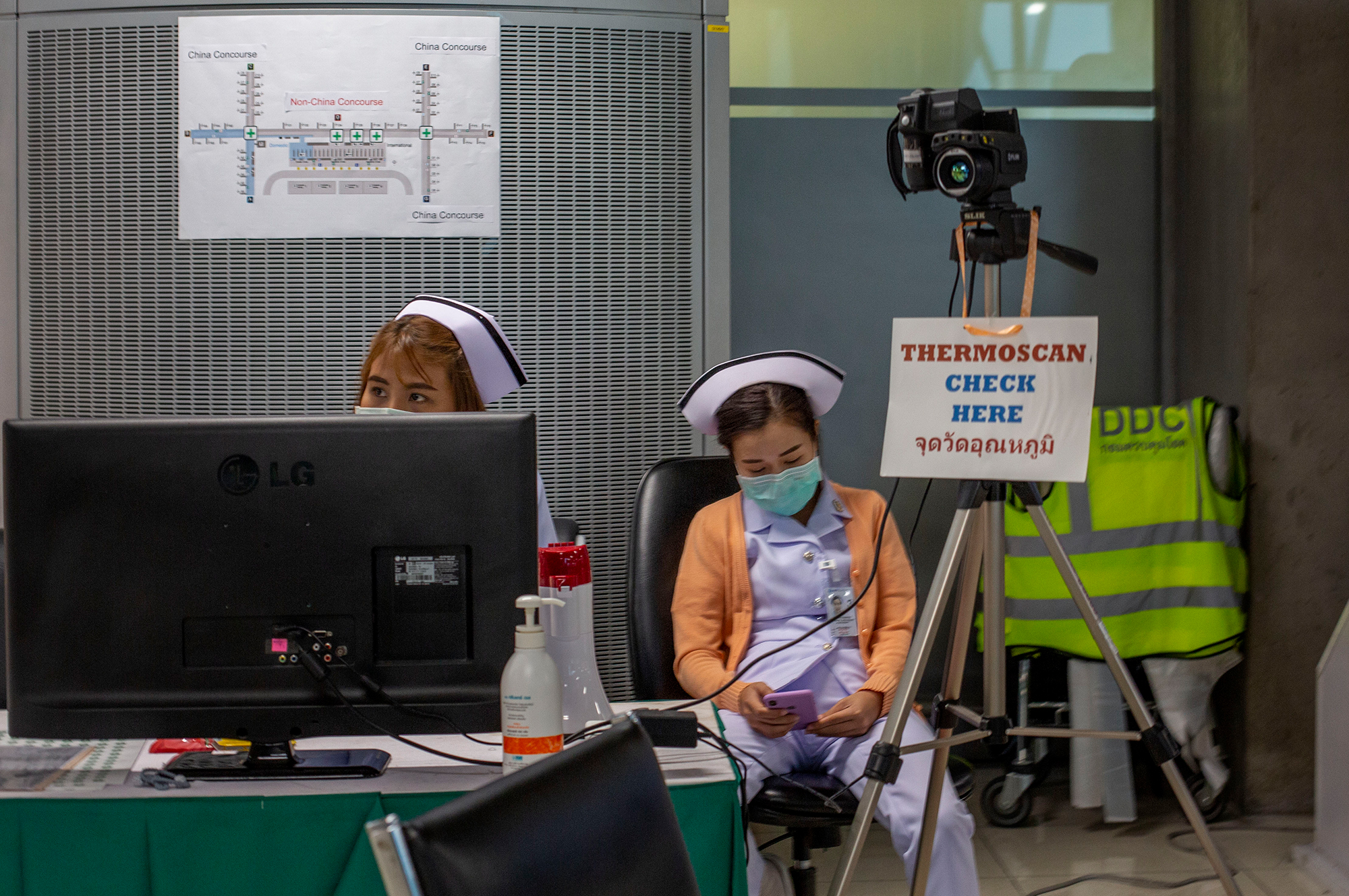 Thai public health officers operate a health checkpoint with a thermo scan at Suvarnabhumi International airport in Bangkok.