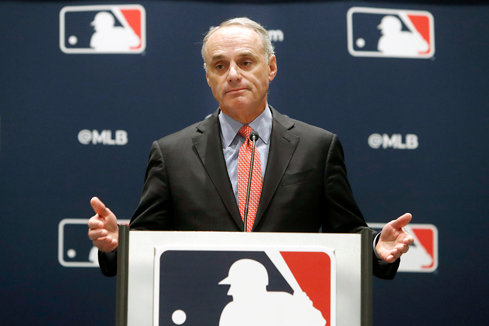 In this Nov. 21, 2019 file photos, baseball commissioner Rob Manfred speaks to the media in Arlington, Texas.