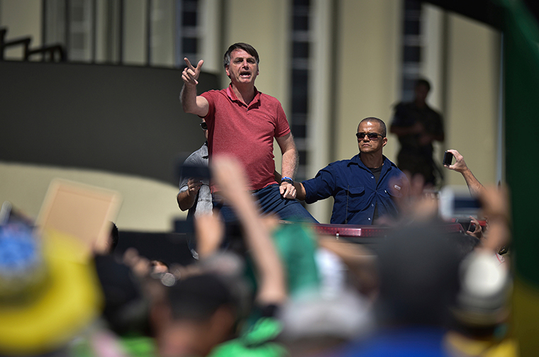 Brazil's President Jair Bolsonaro speaks to supporters during a protest in front the army's headquarters during the Army day, amid the new coronavirus pandemic, in Brasilia, Brazil, Sunday, April 19.