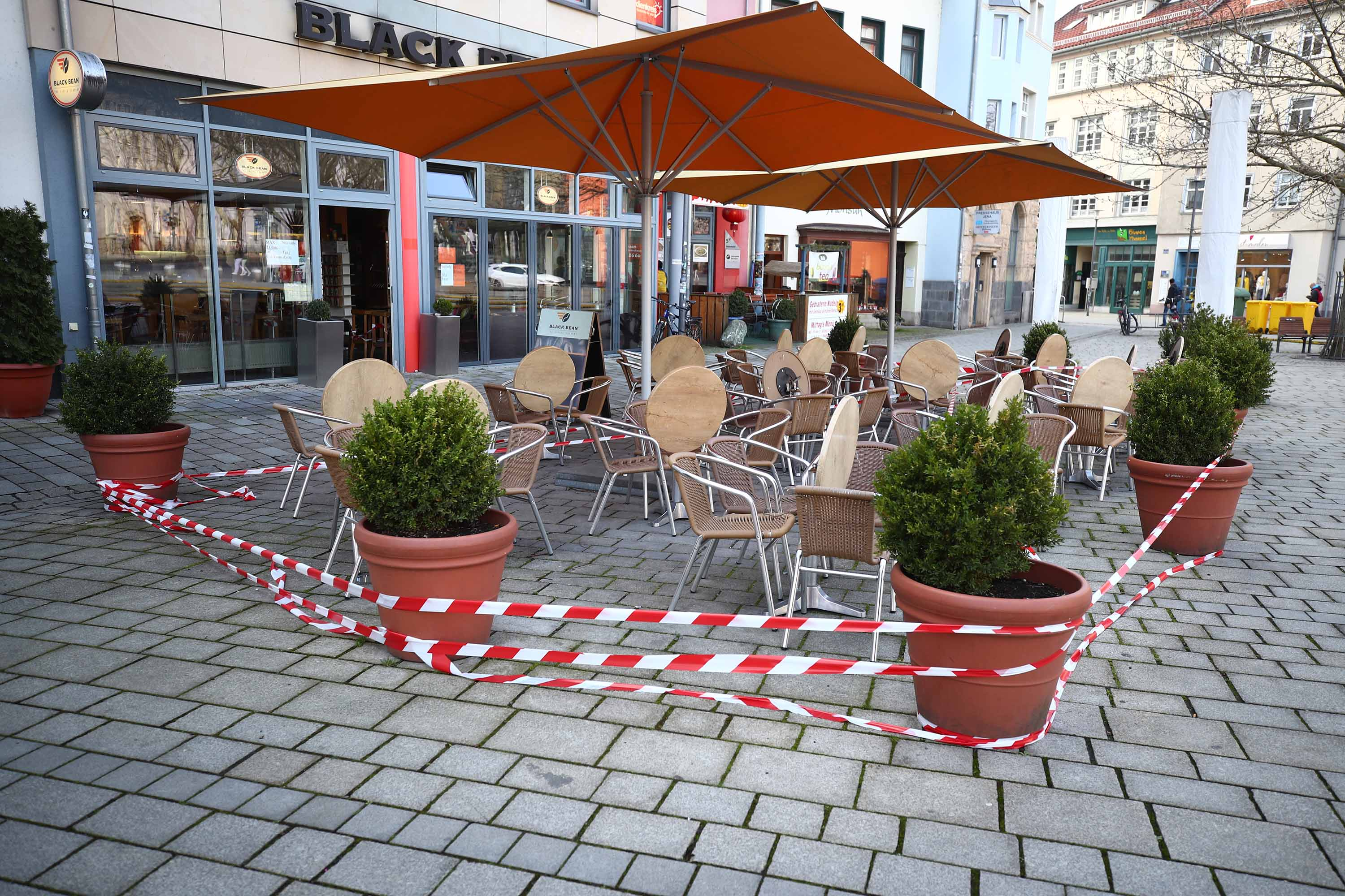 A restaurant's outside dining area is seen taped off in Jena, Germany, on March 18.