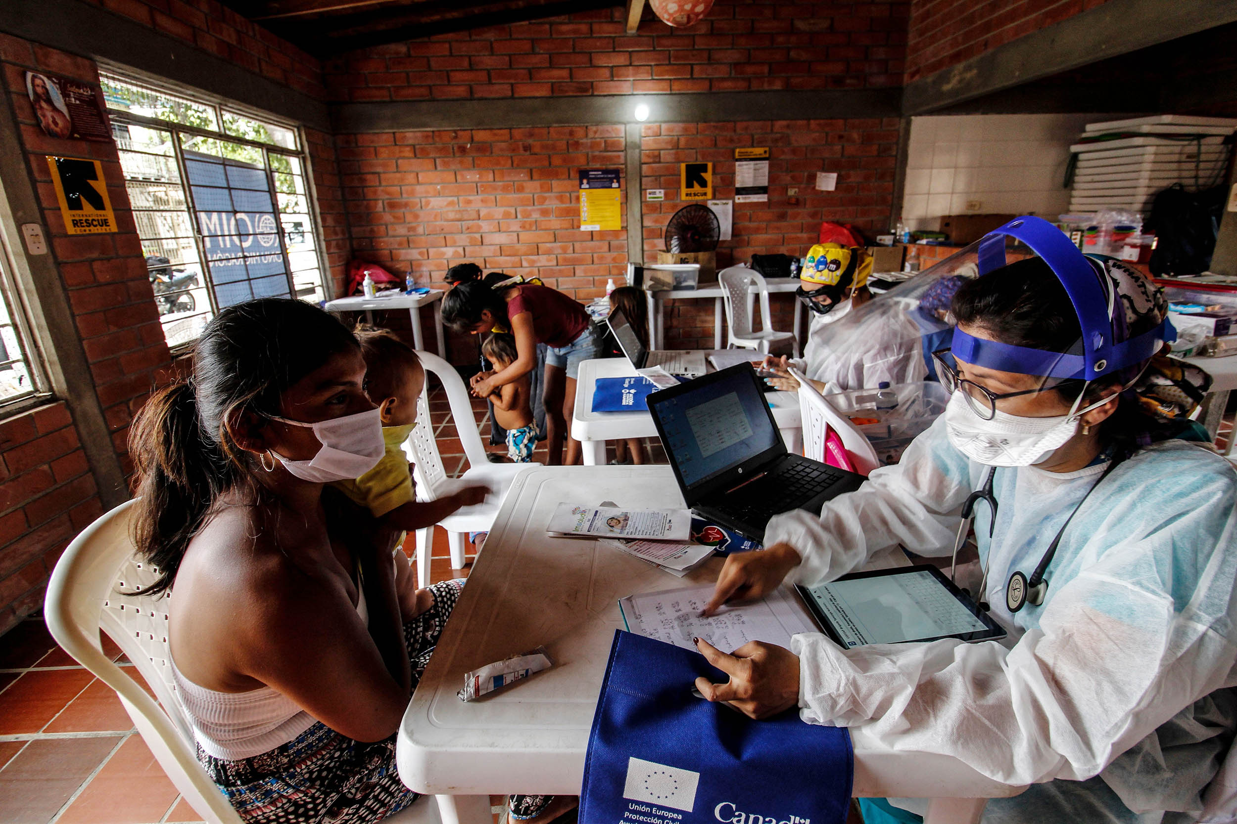 Staffers from Colombia's Secretary of Health check Venezuelan Yukpa indigenous ethnic group member, in Cucuta, Venezuela on July 9, amid the COVID-19 pandemic.