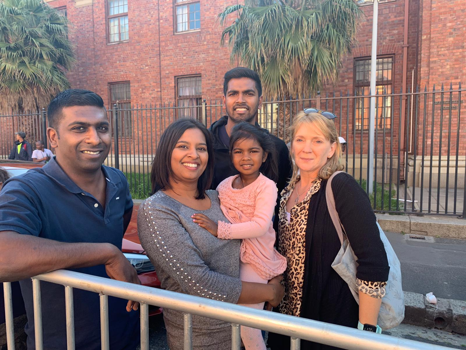Sue Freeling, pictured far right, stands with the Roxanne Naidoo, her daughter Michaela Grace, husband Mark and family member Nigel Govindamsami.