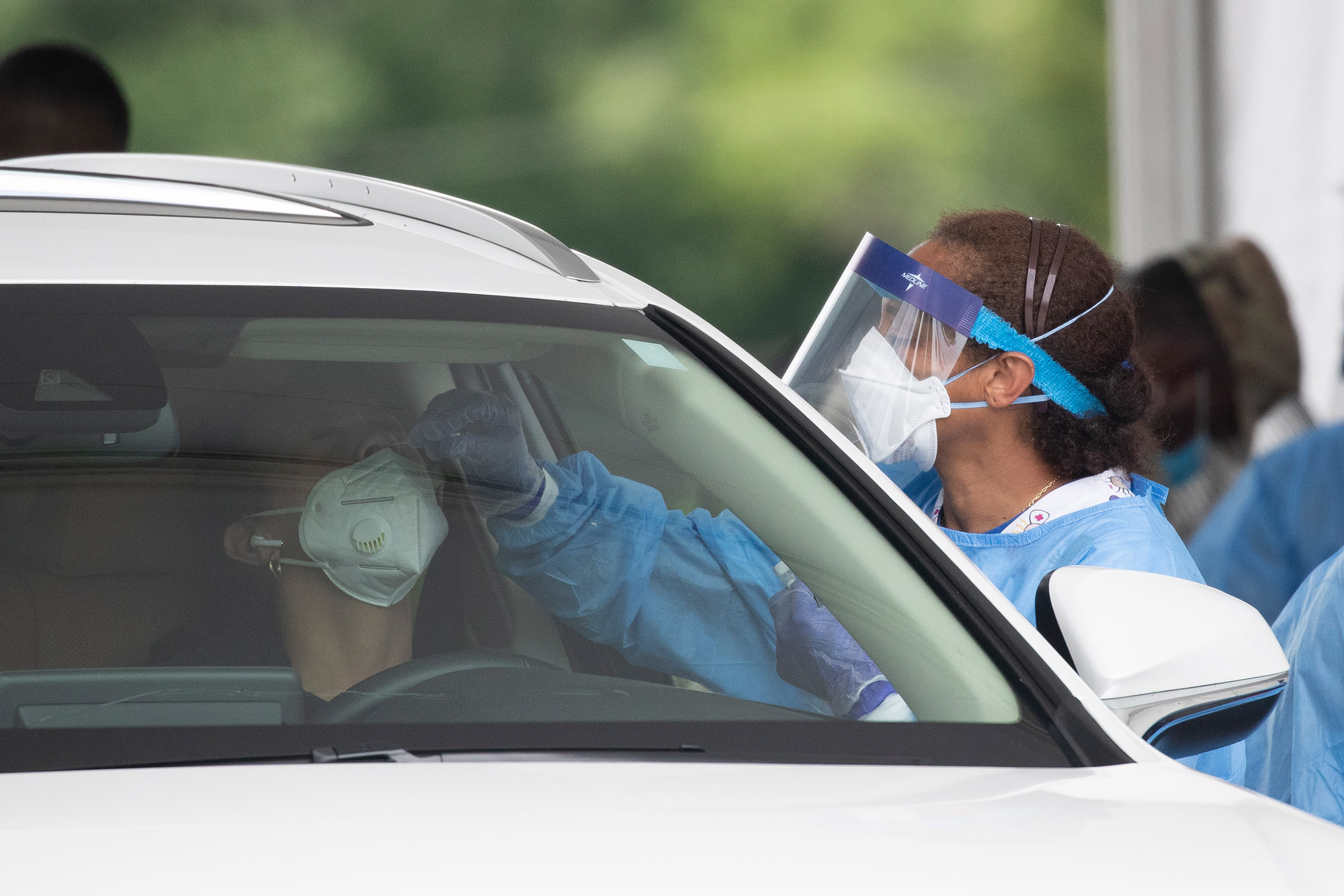 People are treated for COVID-19 at Dekalb County testing site on July 8 in Tucker, Georgia.