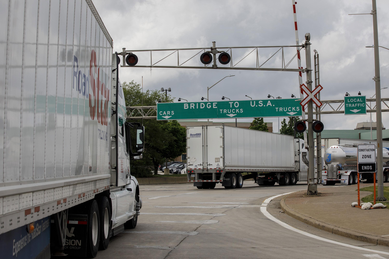 Trucks enter a queue to cross the Ambassador Bridge into Detroit, Michigan, from Windsor, Ontario, on May 26.