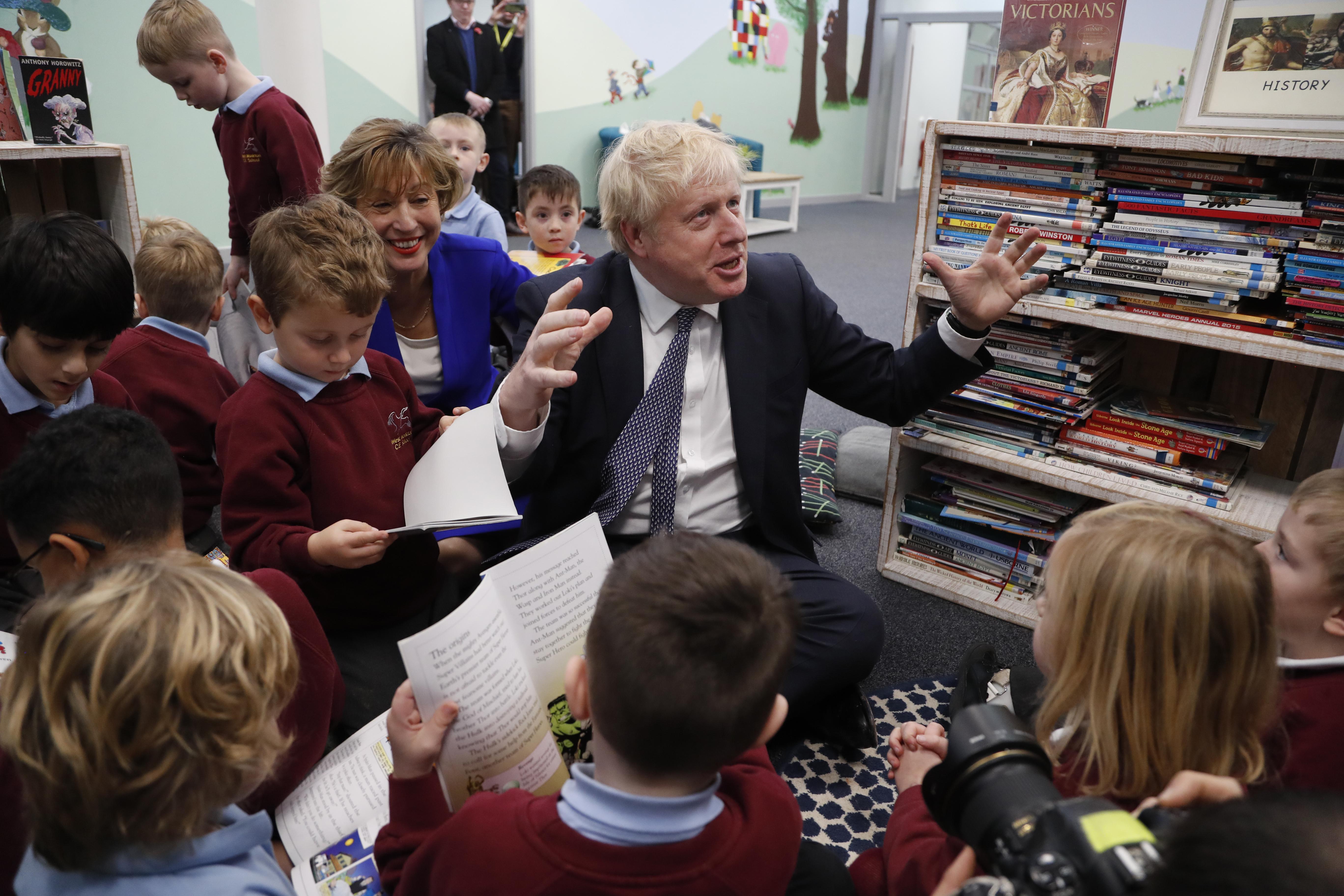 Conservative Party leader Boris Johnson entertains children in West Monkton.