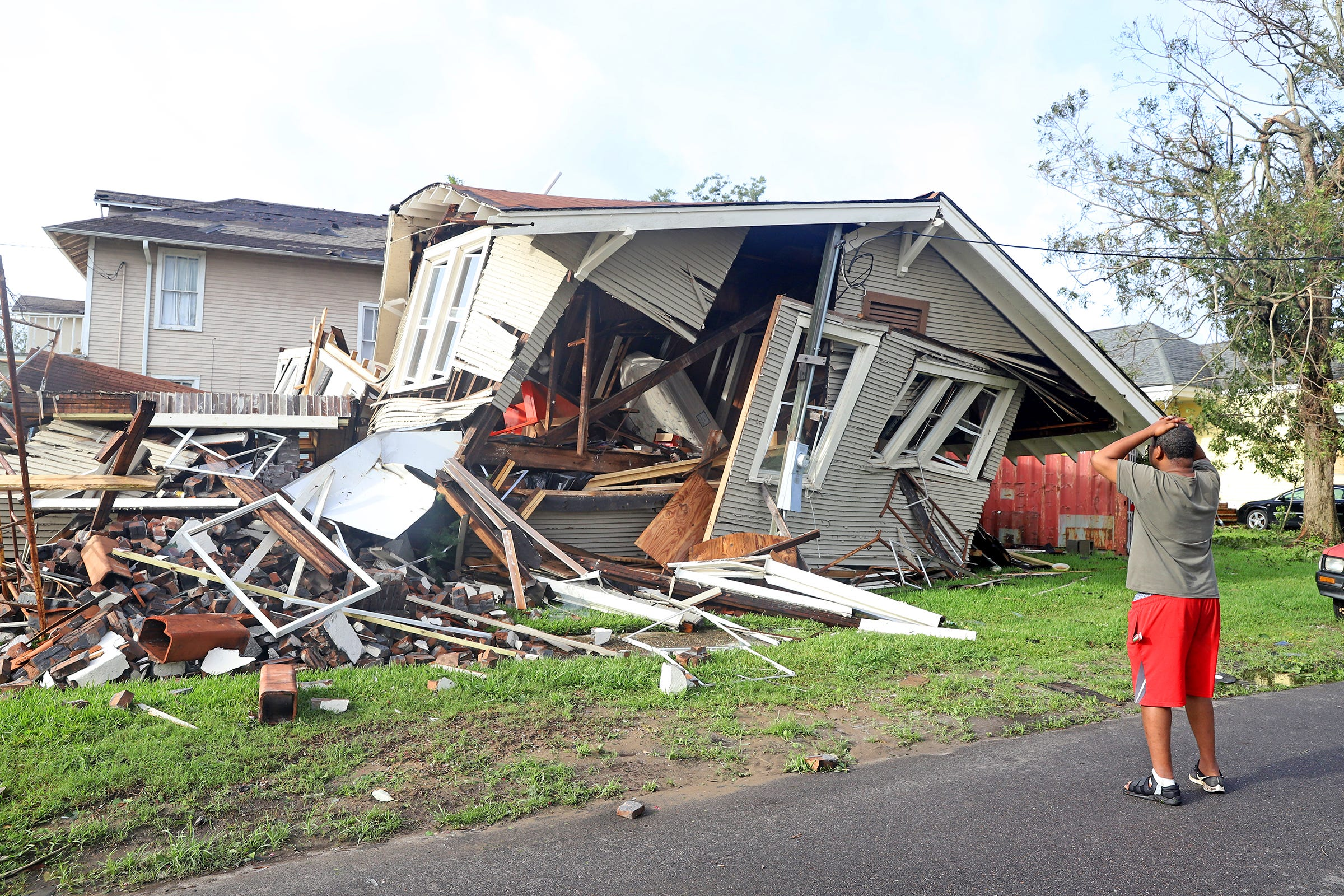 Dartanian Stovall looks at the house that collapsed with him inside during the height of Hurricane Ida in New Orleans.