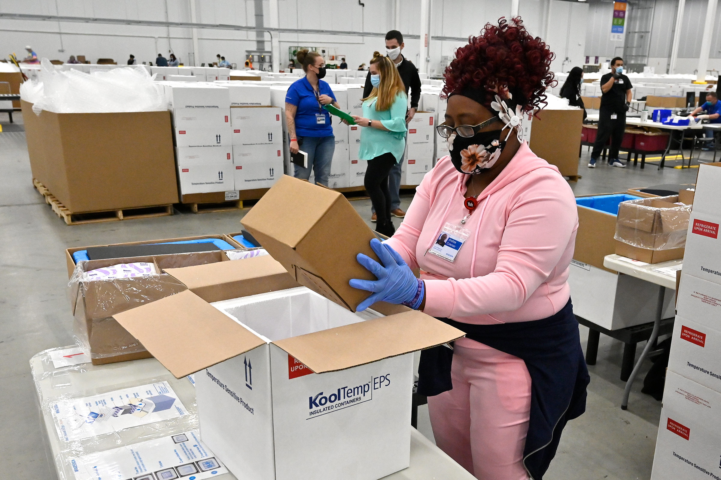An employee with the McKesson Corporation packs a box of Johnson & Johnson Covid-19 vaccines for shipping in Shepherdsville, Kentucky, on March 1.