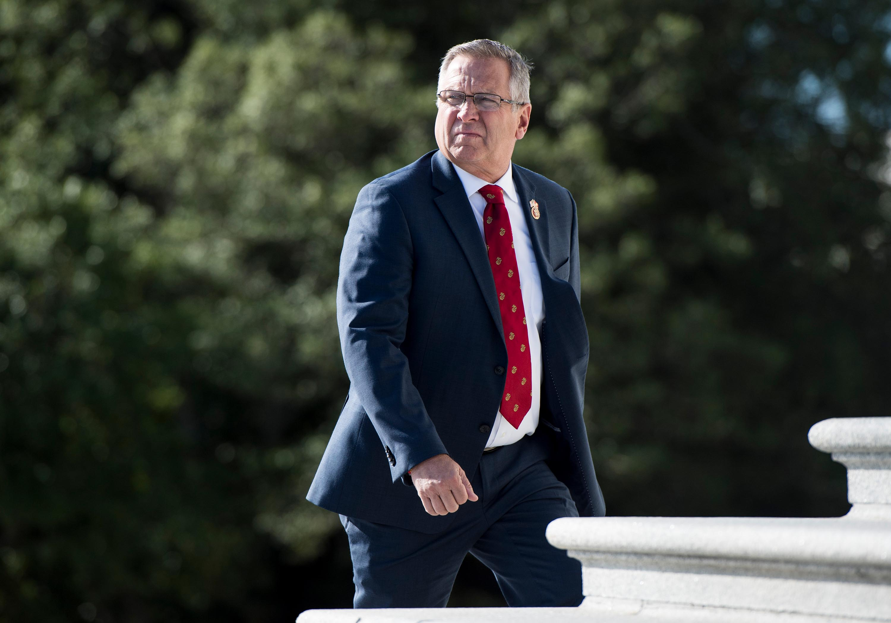 Rep. Mike Bost walks up the House steps in October 2019.