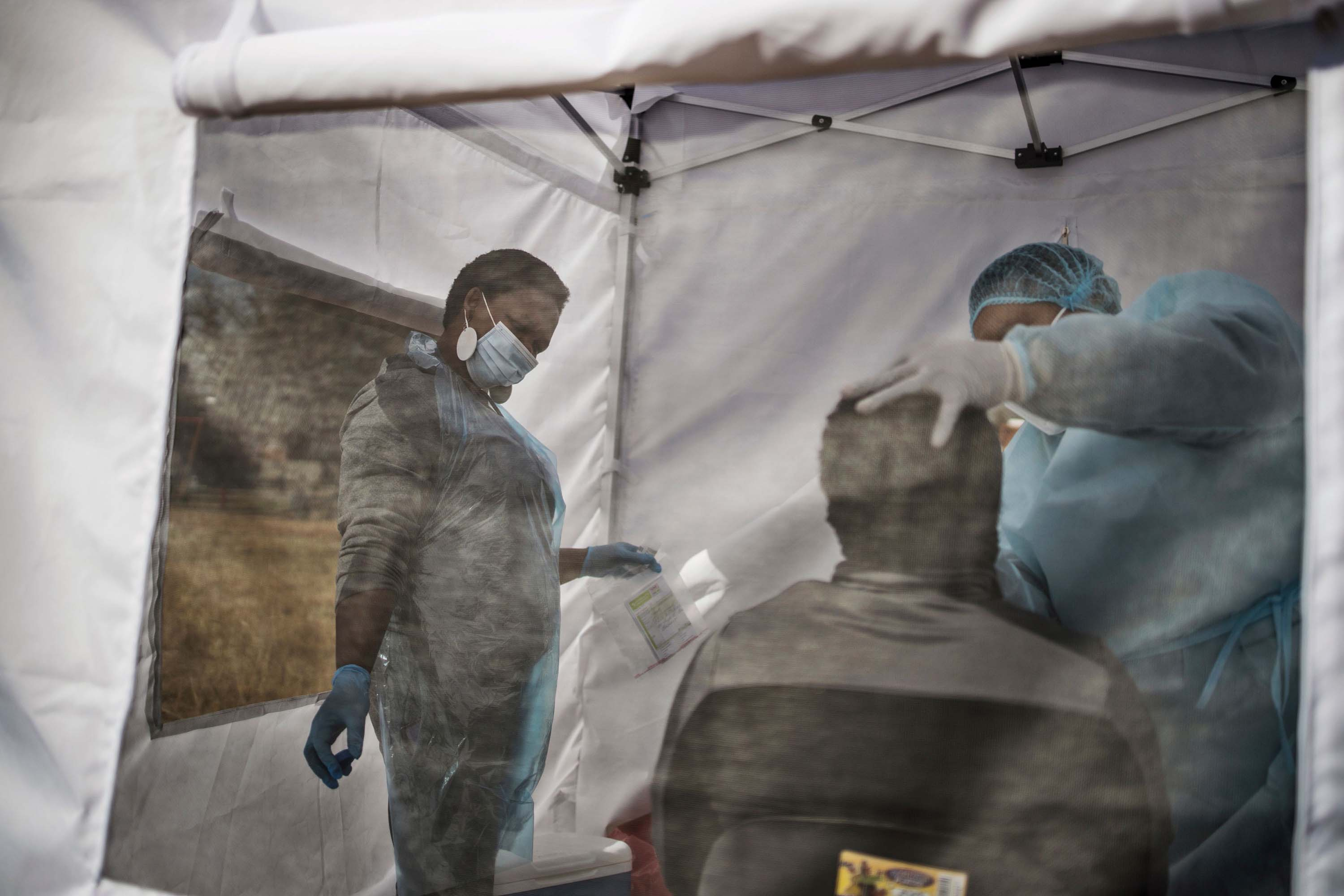 A man is tested for coronavirus in Vrededorp, Johannesburg, on June 5.