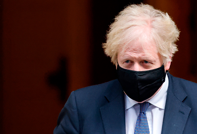 Britain's Prime Minister Boris Johnson leaves 10 Downing street in London on January 6, 2021.