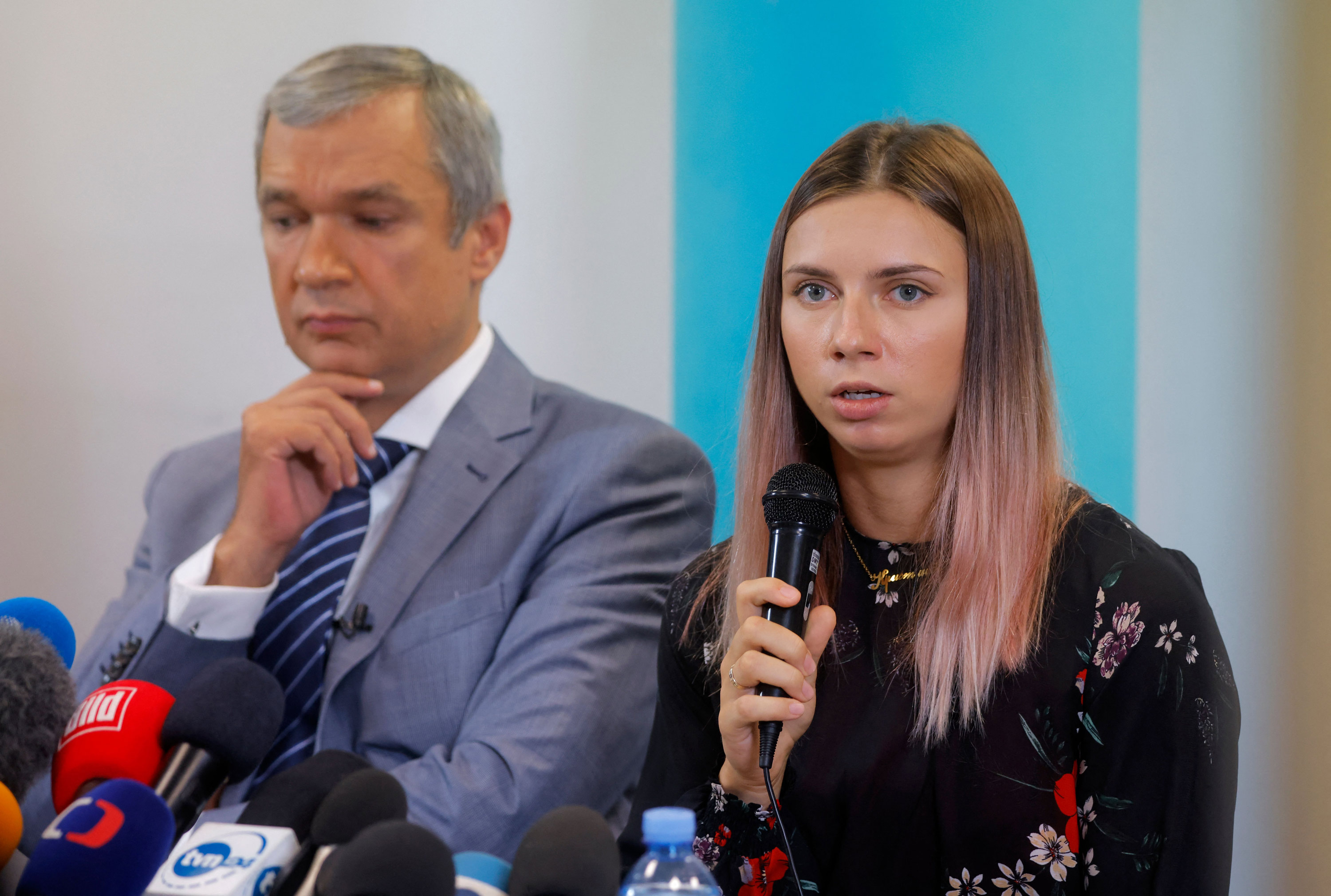 Belarusian Olympic athlete Kristina Timanovskaya, right, and Belarusian opposition politician Pavel Latushko address a press conference on August 5 in Warsaw, Poland.