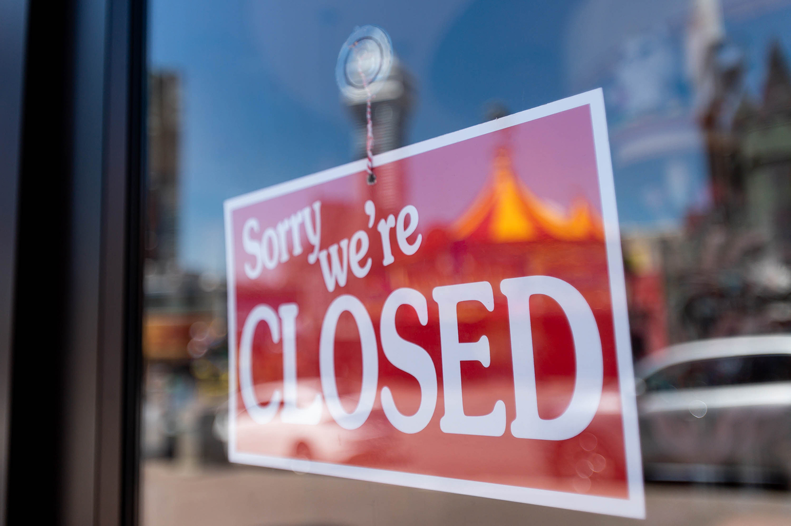 A closed sign in the town of Niagara Falls is seen on April 27 in Niagara Falls, Canada. Tourist attractions across Canada have been hit hard by the Covid-19 pandemic.