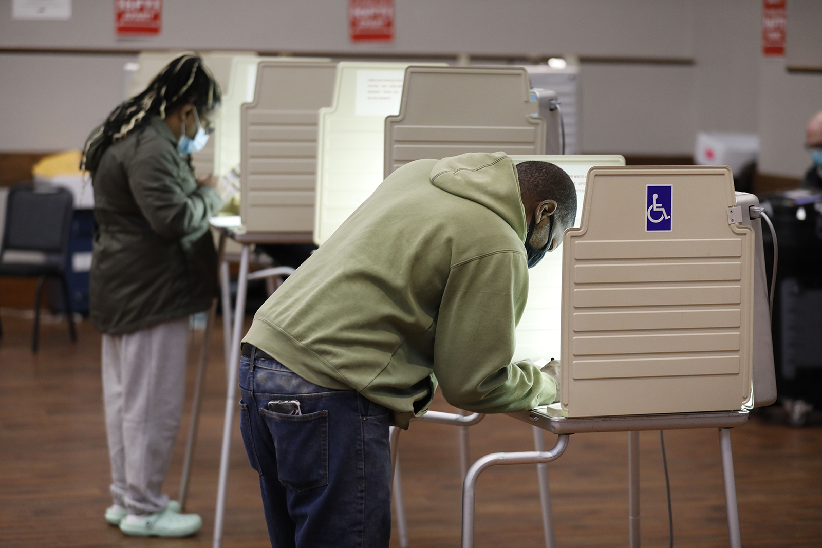 People vote in the 2020 general election at the Northwest Activities Center on November 3, in Detroit.