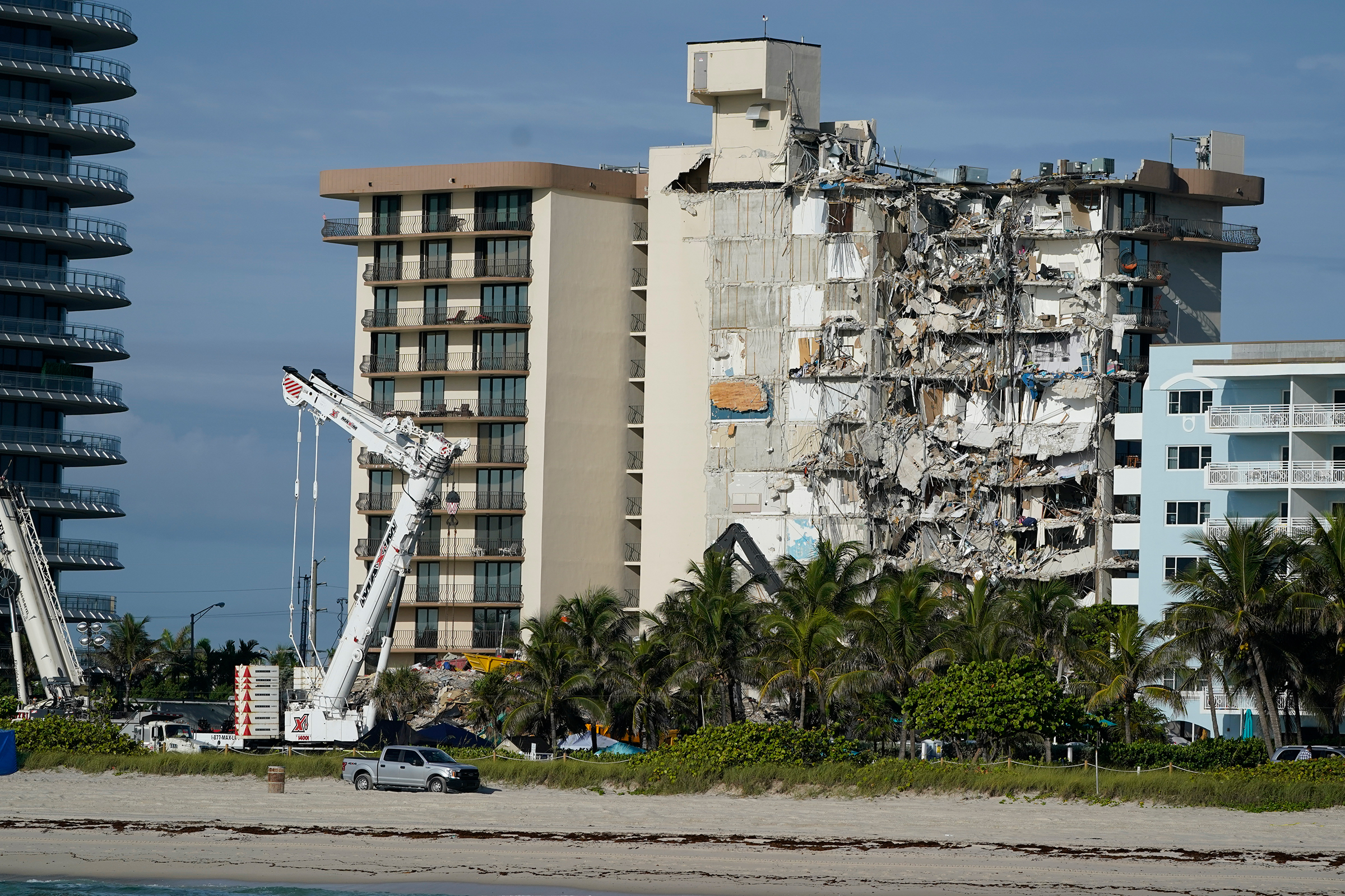 Heavy machinery sits in front of the partially collapsed Champlain Towers South condo building, on Thursday, July 1, in Surfside, Florida.