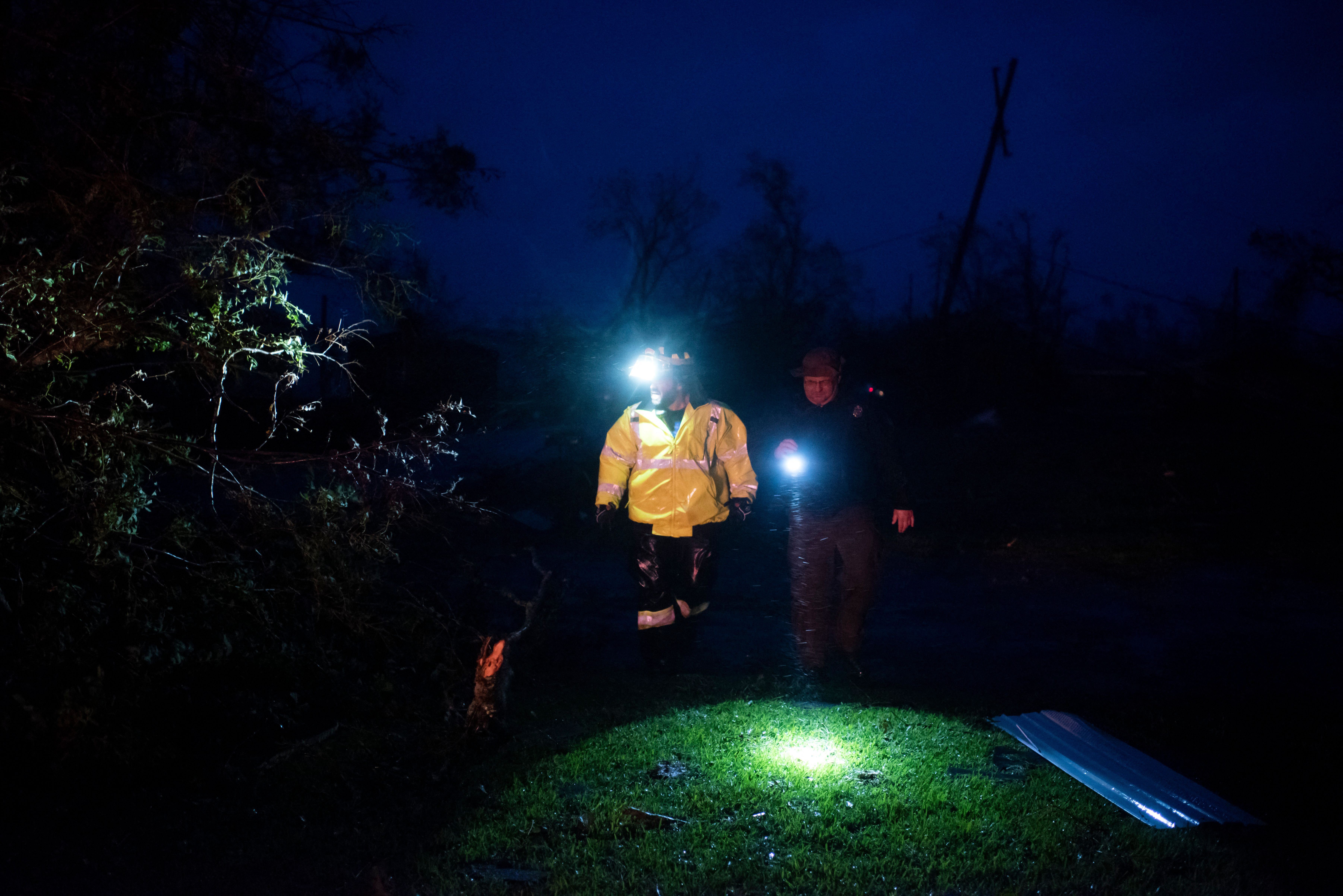 Montegut and Bourg firefighters inspect downed trees on a road in Bourg, Louisiana as Hurricane Ida passes on Aug. 29, 2021.