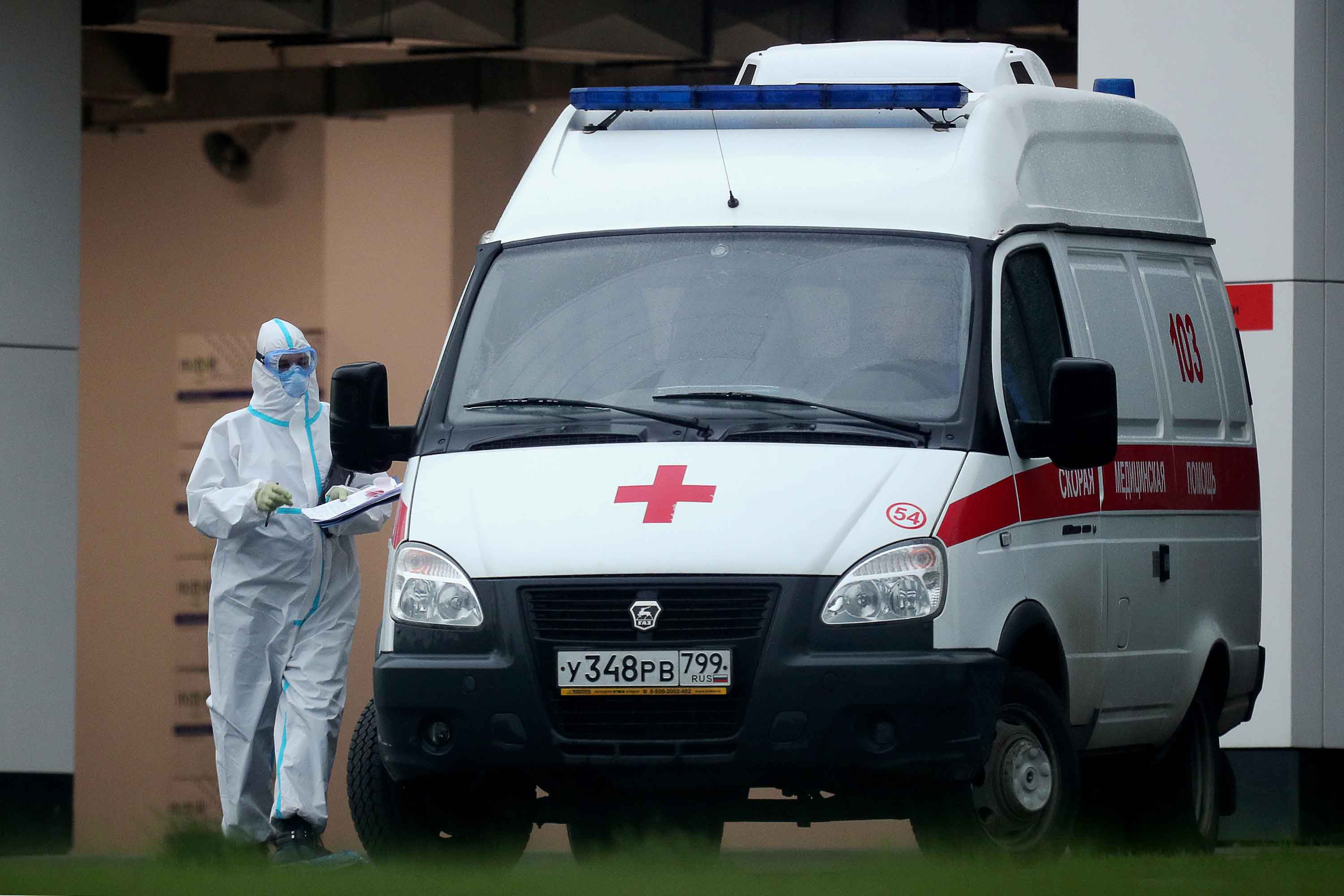 An emergency paramedic is seen by an ambulance at a Moscow medical center for patients suspected to be infected with Covid-19, on May 14.