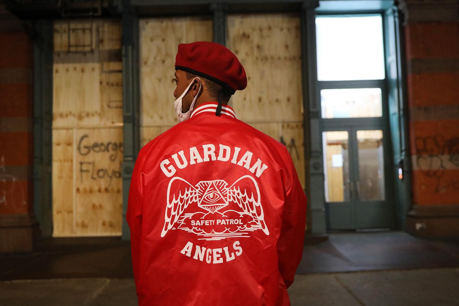 Members of the Guardian Angels, a volunteer organization of unarmed citizens which began in the late 1970's, stand guard near looted stores during a night of protests and vandalism over the death of George Floyd on June 1, 2020 in New York City.